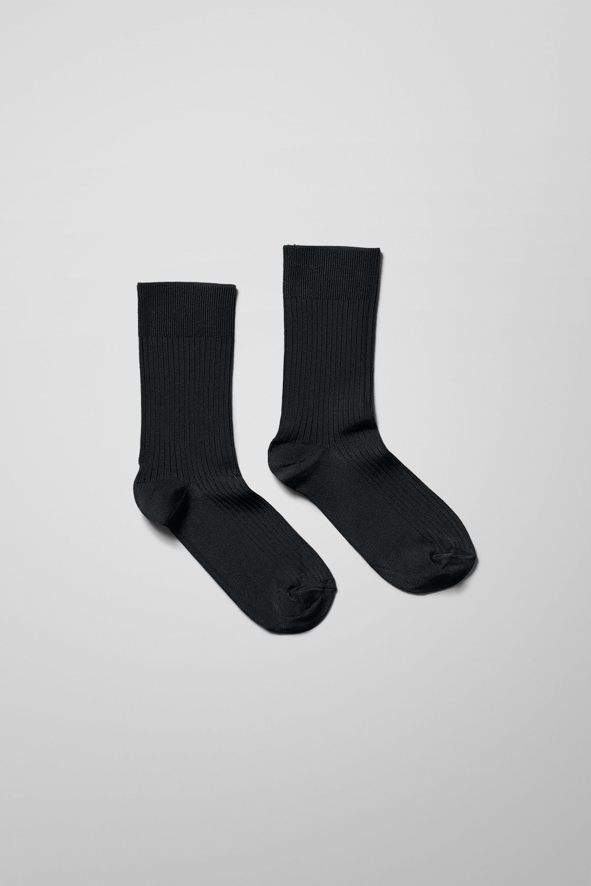 Front image of Weekday lo socks in black
