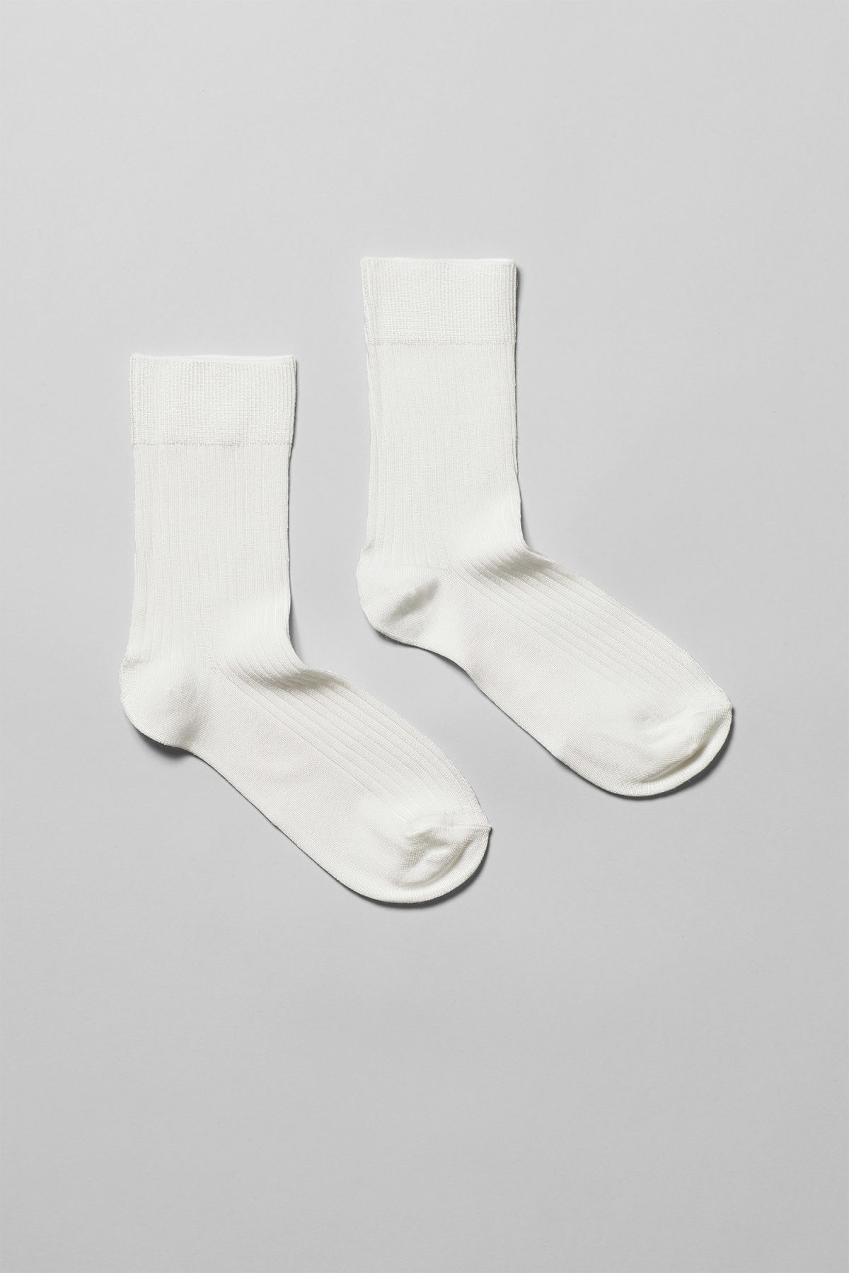 Front image of Weekday lo socks in white