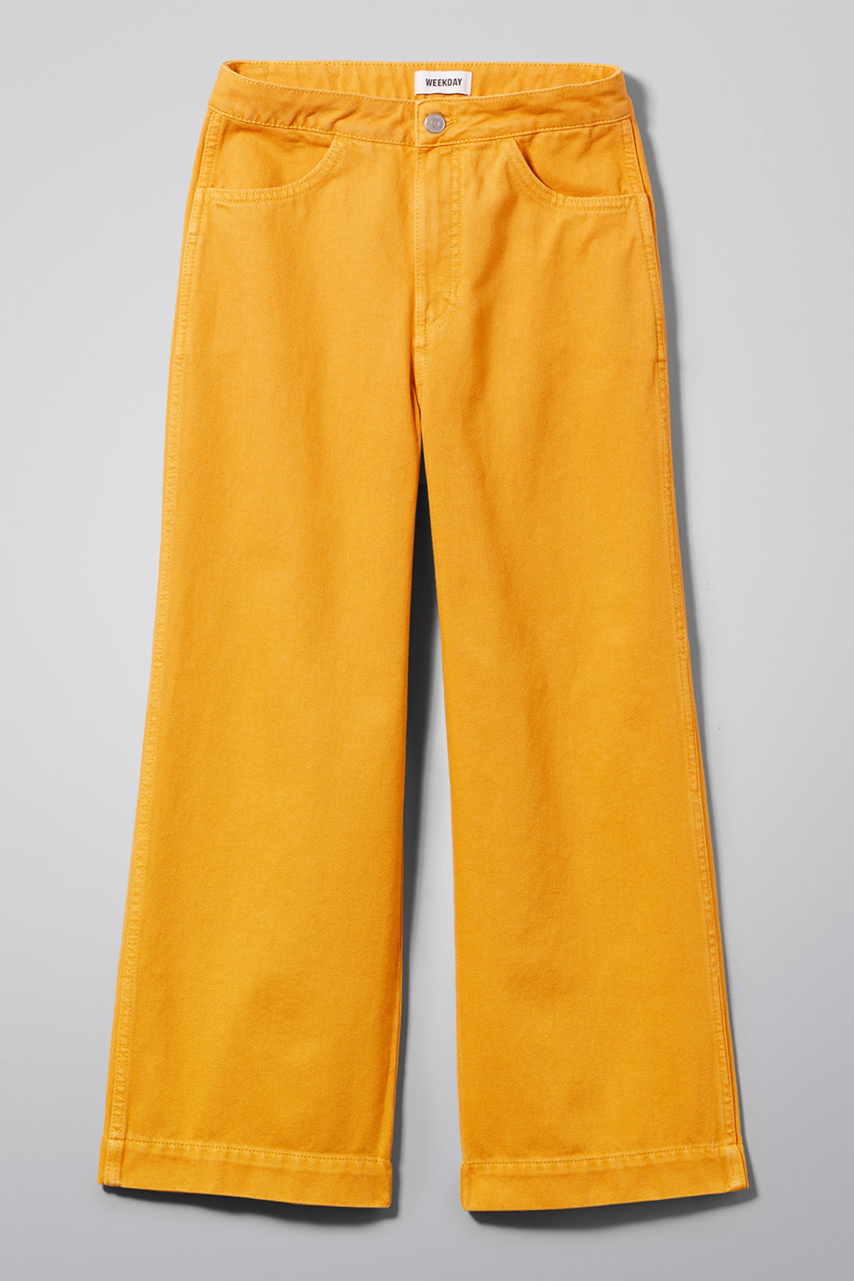 Front image of Weekday vida yellow denim trousers in yellow