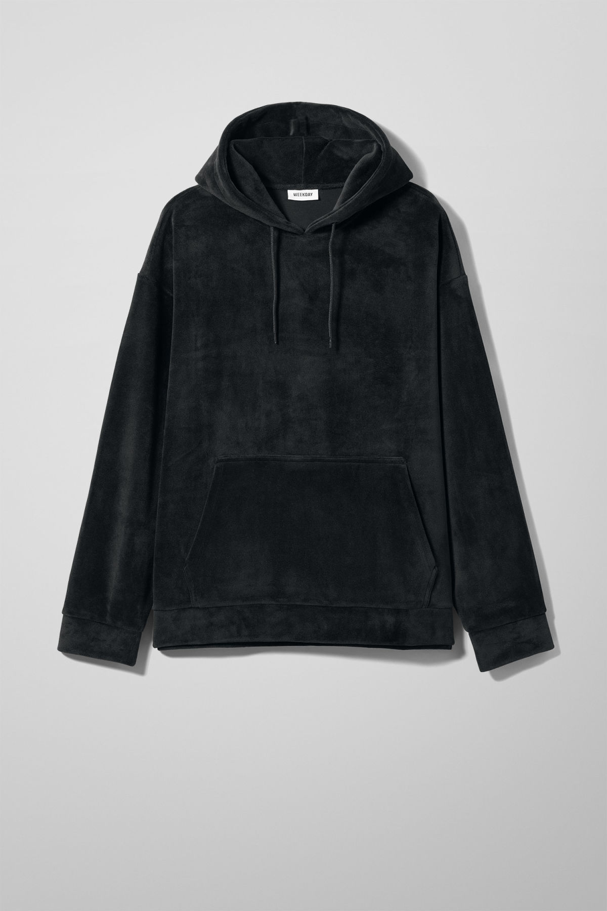 Front image of Weekday big hawk velvet hoodie in black