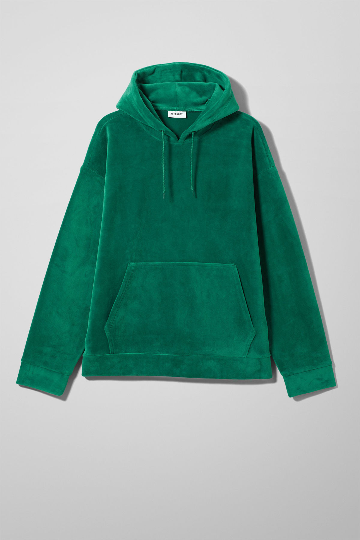 Front image of Weekday big hawk velvet hoodie in green