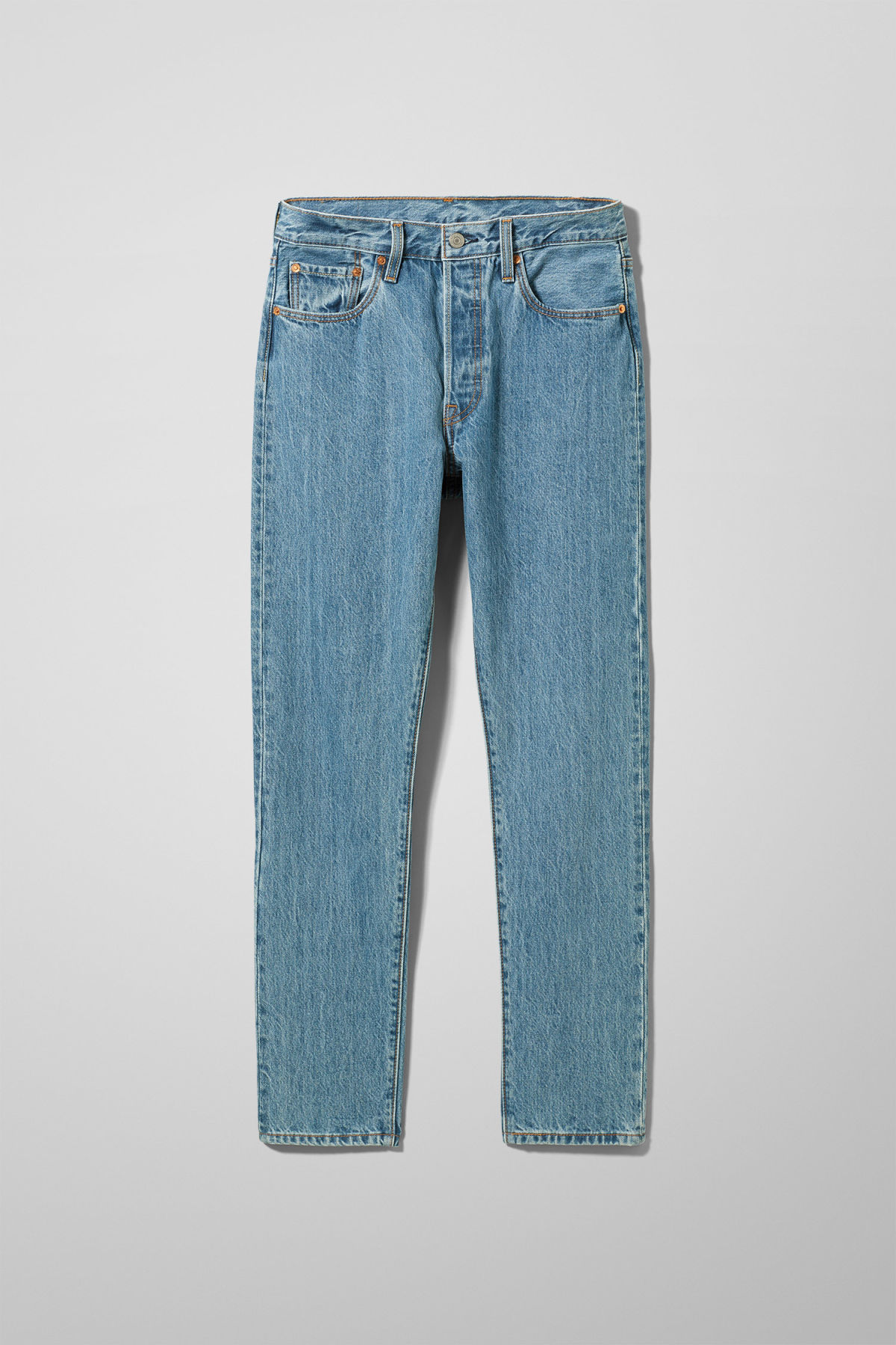 Front image of Weekday 501 skinny rolling dice jeans in blue