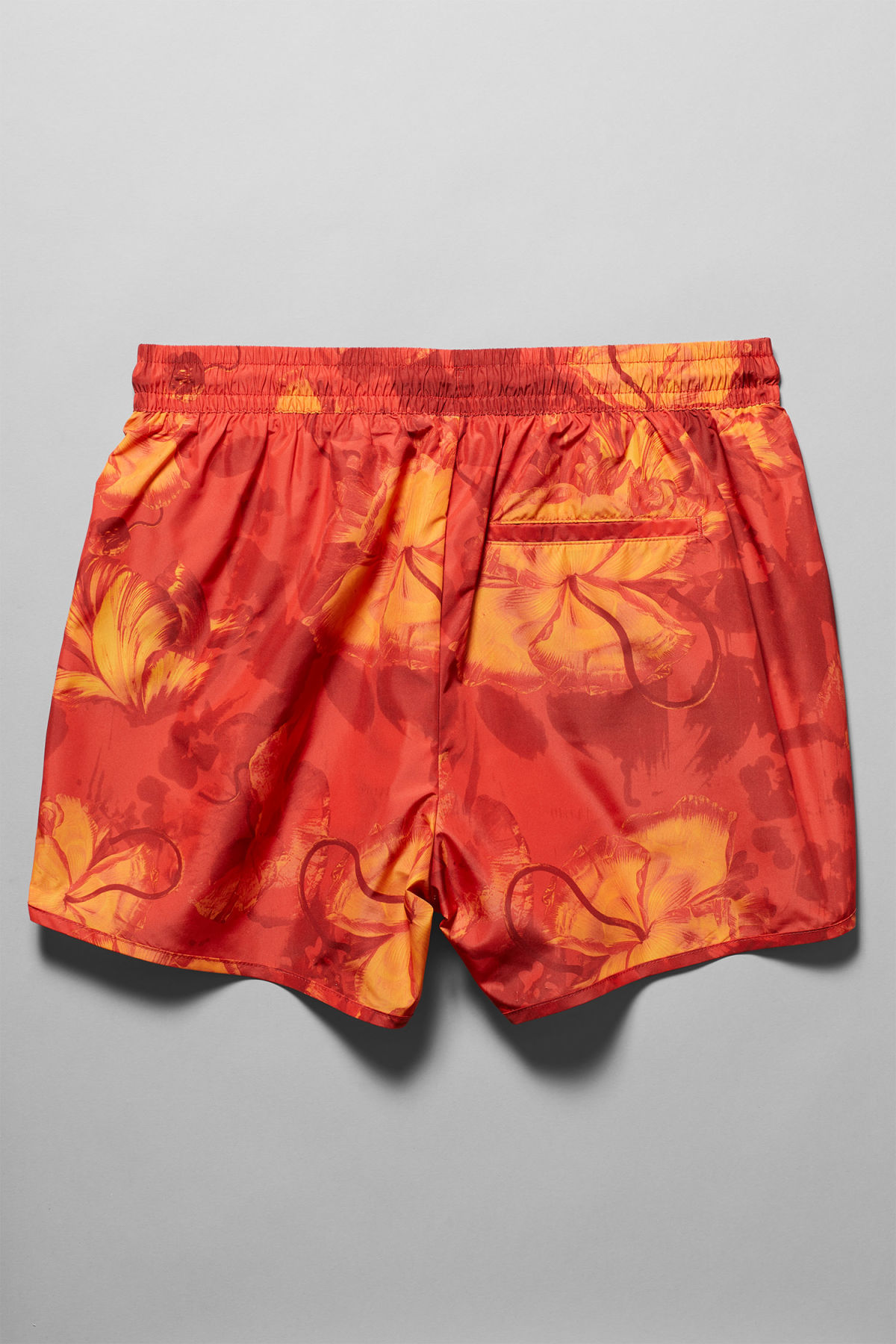 Back image of Weekday tan aop swim shorts in red