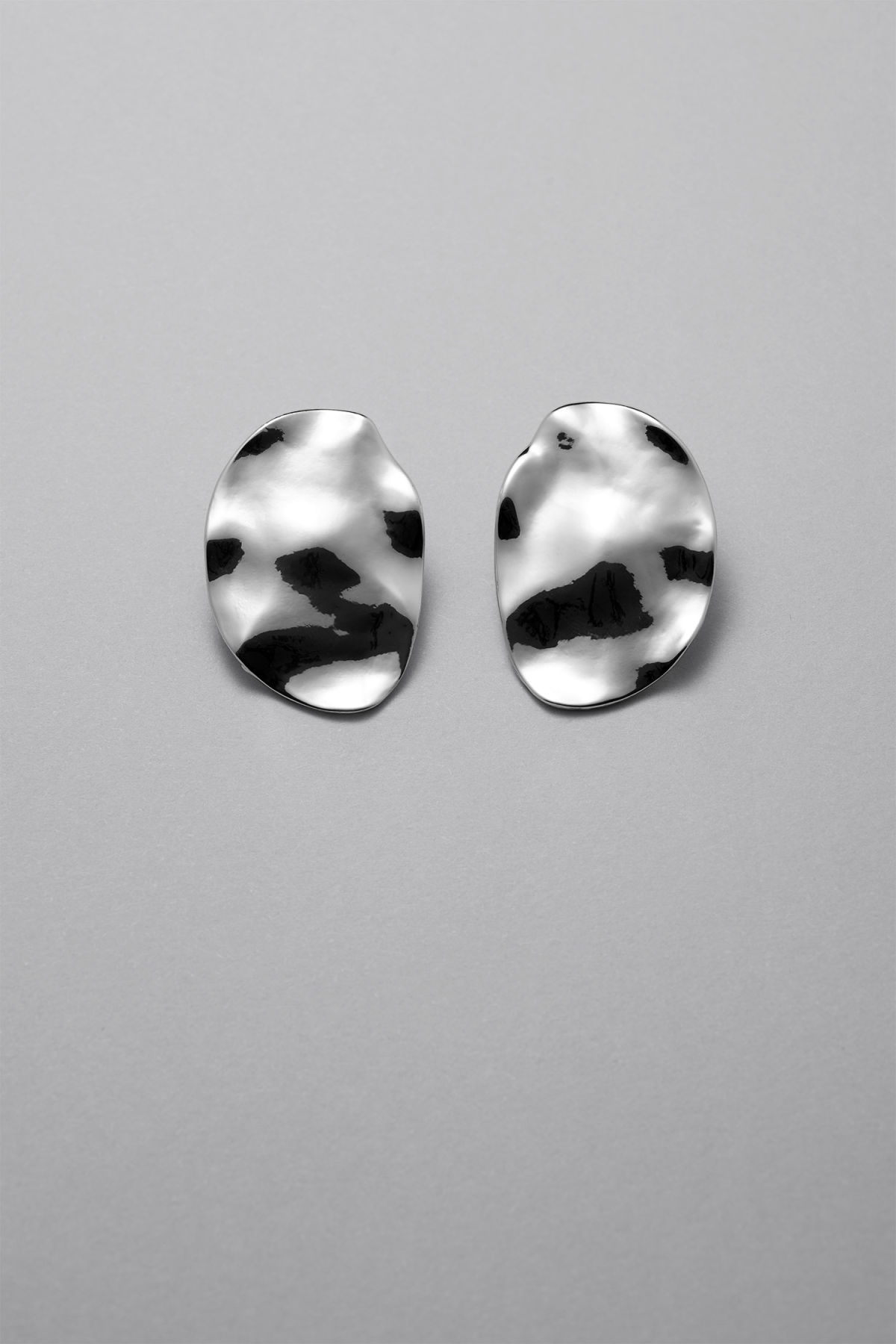 Front image of Weekday ocean earrings in silver