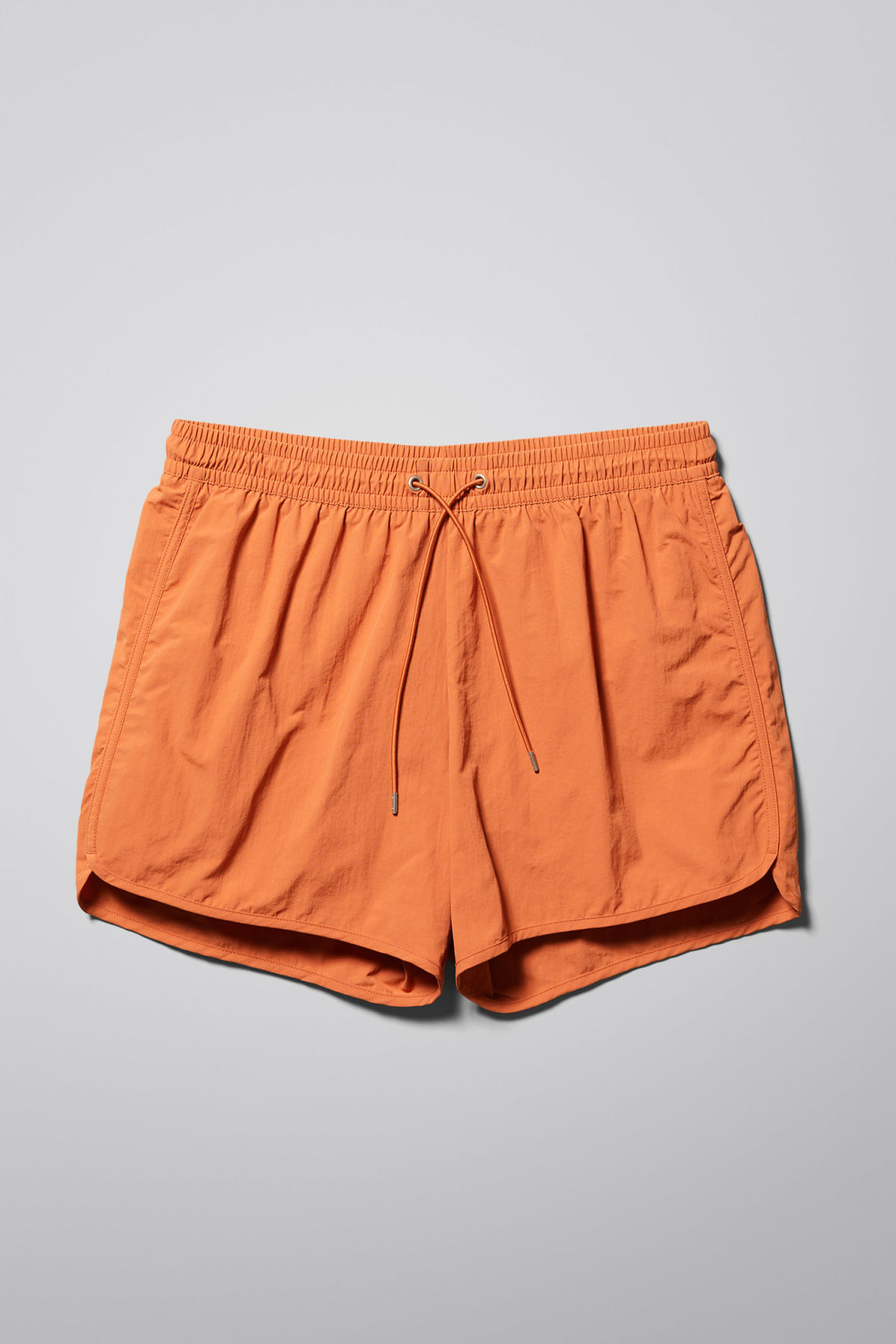 Front image of Weekday tan structure swim shorts in orange