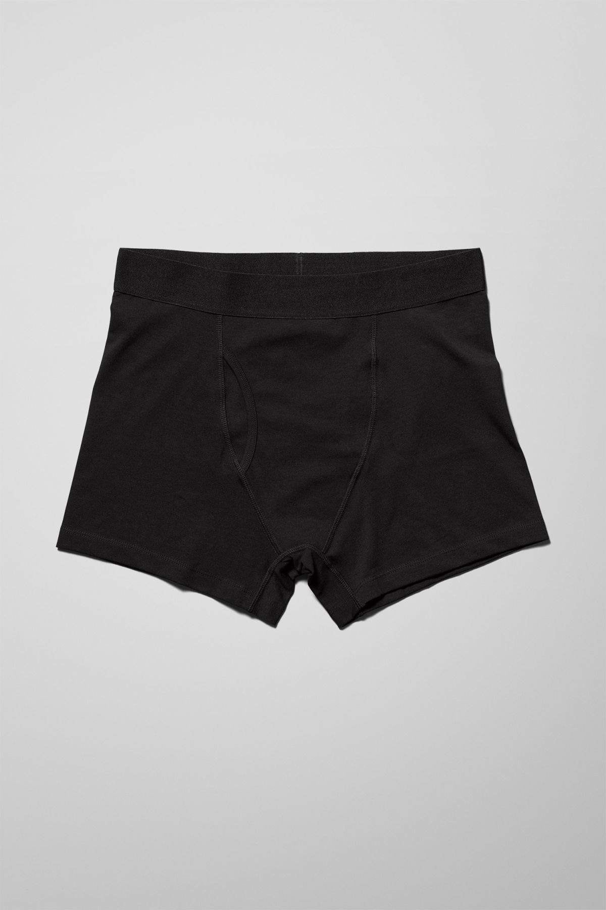 Front image of Weekday johnny trunks in black
