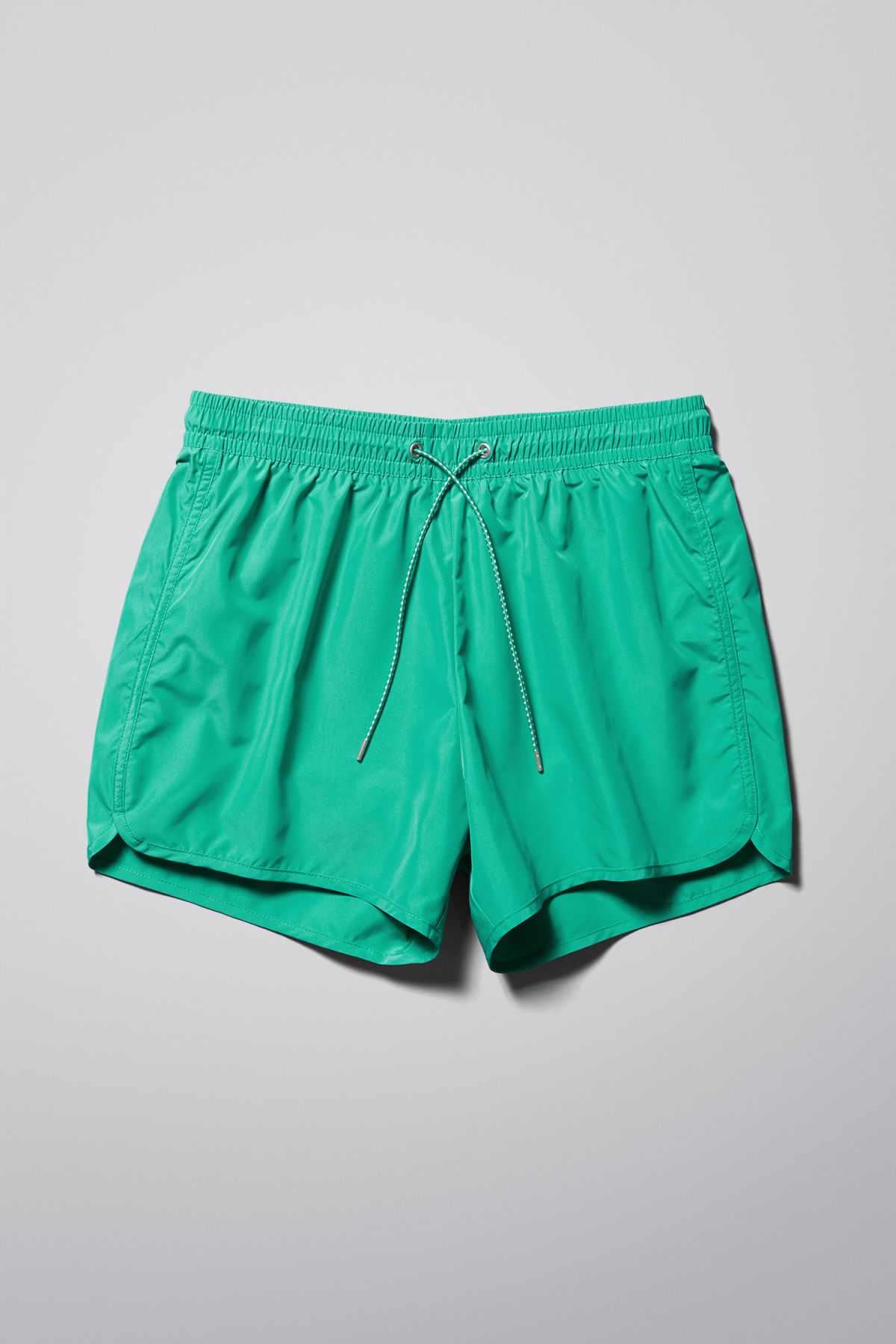 Front image of Weekday tan swim shorts  in green