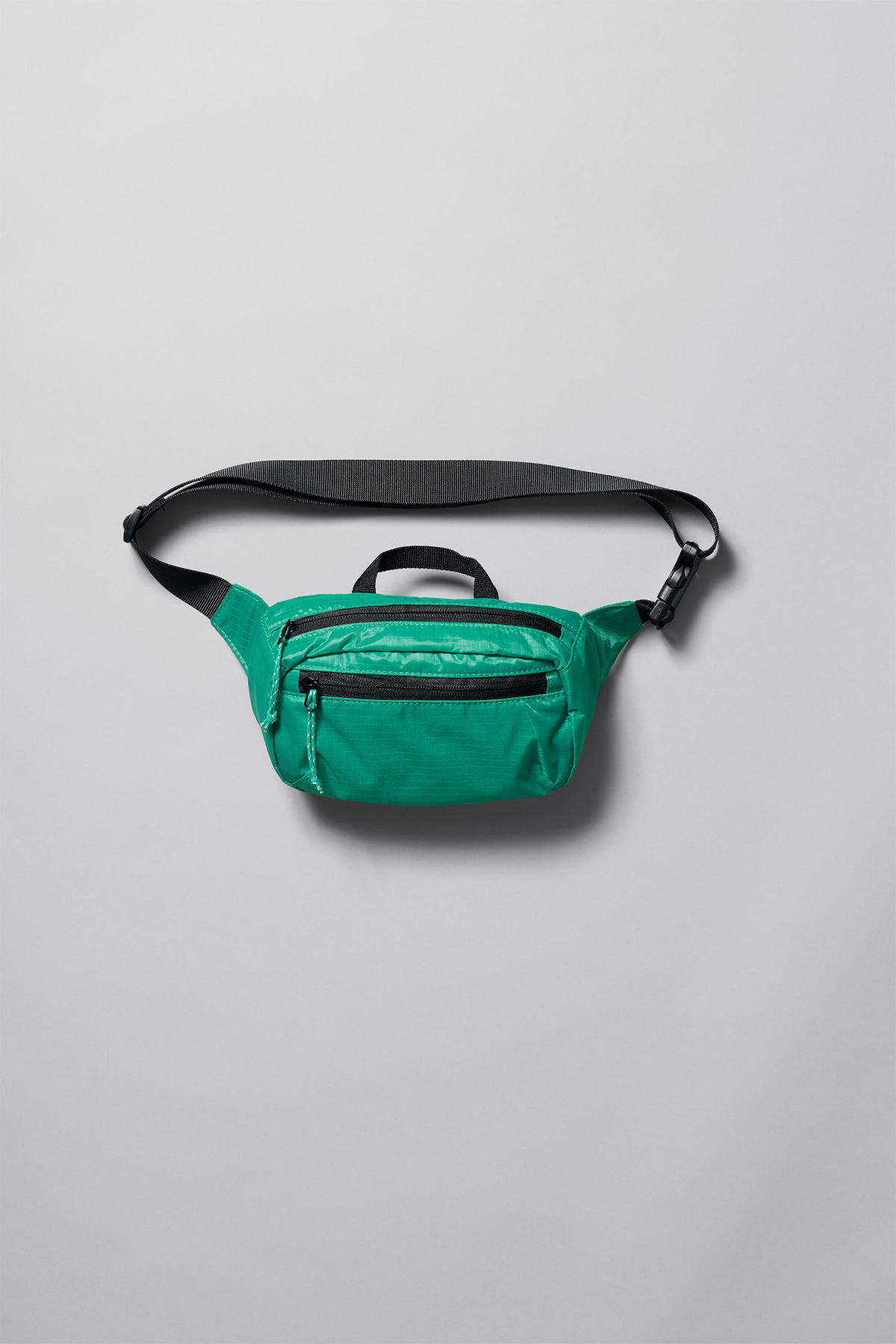 Front image of Weekday trip mini waist bag in green