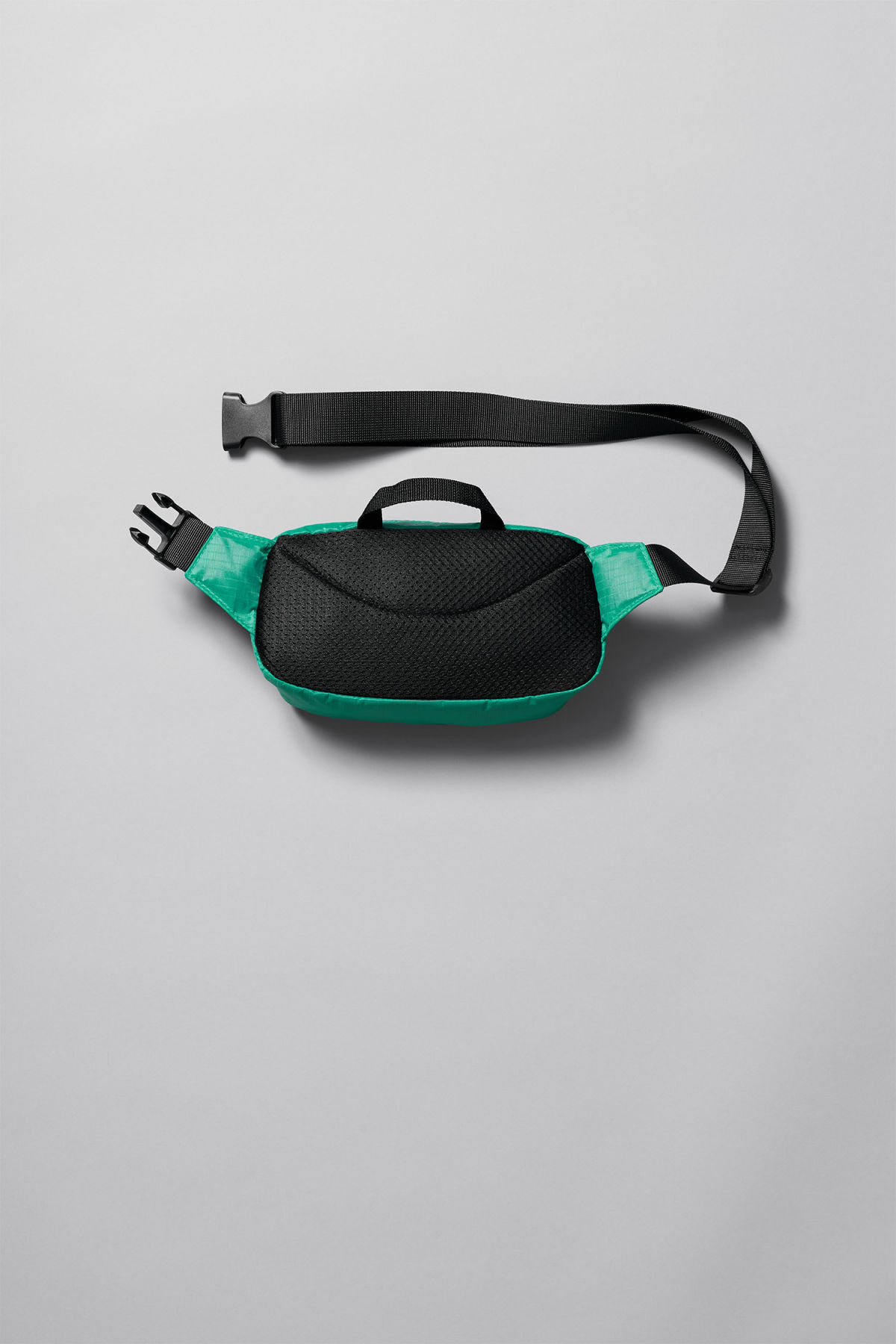 Back image of Weekday trip mini waist bag in green