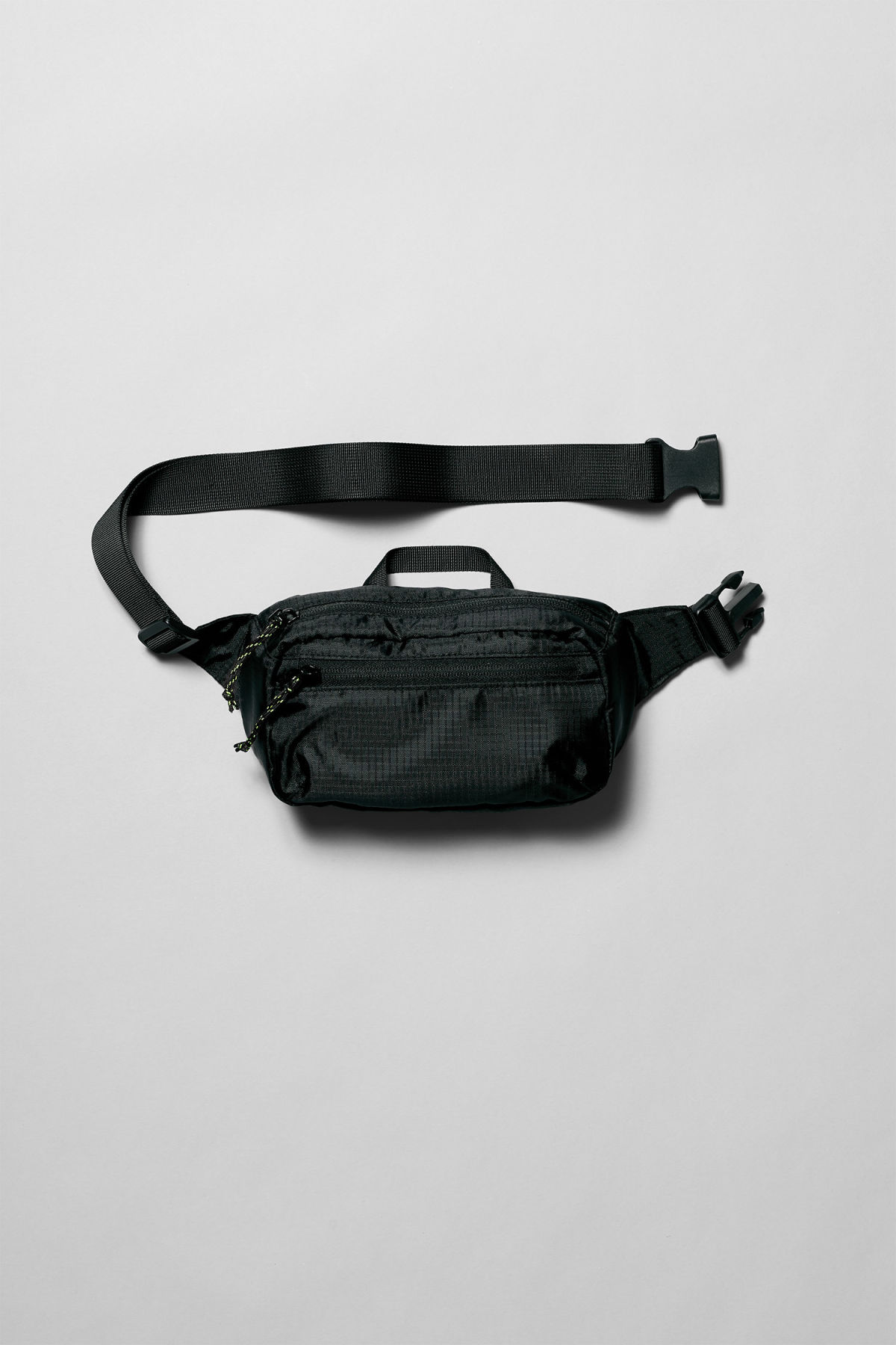 Front image of Weekday trip mini waist bag in black