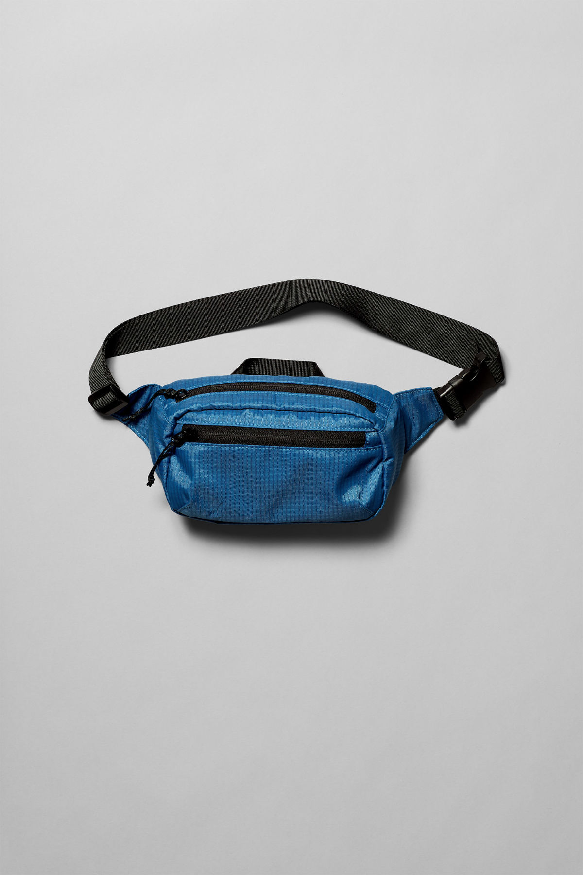 Front image of Weekday trip mini waist bag in blue