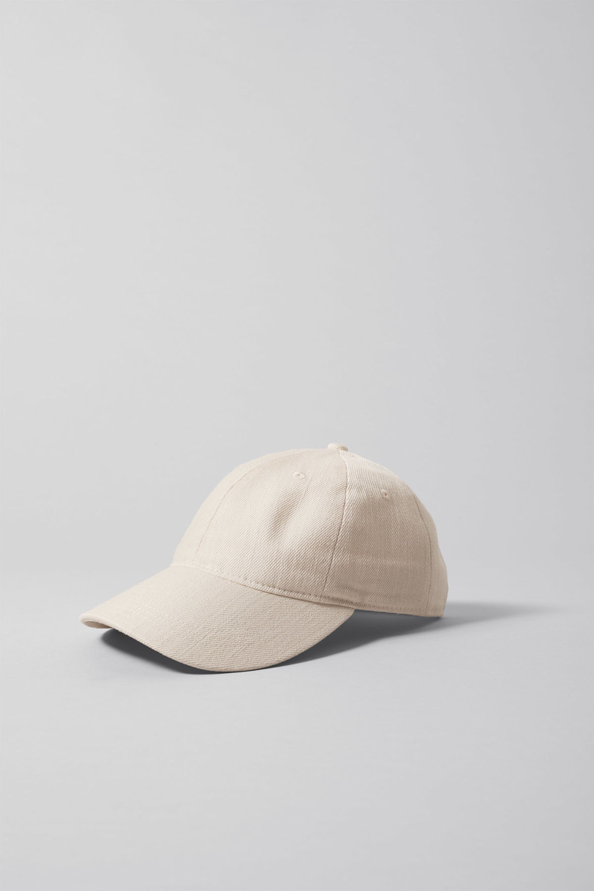 Front image of Weekday ecru cap in white