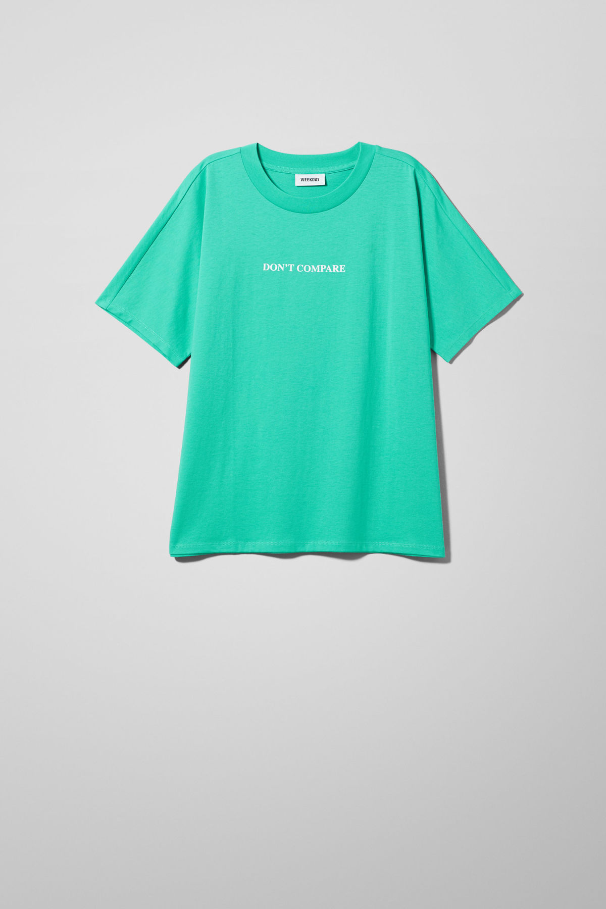 Front image of Weekday vitrine t-shirt in green