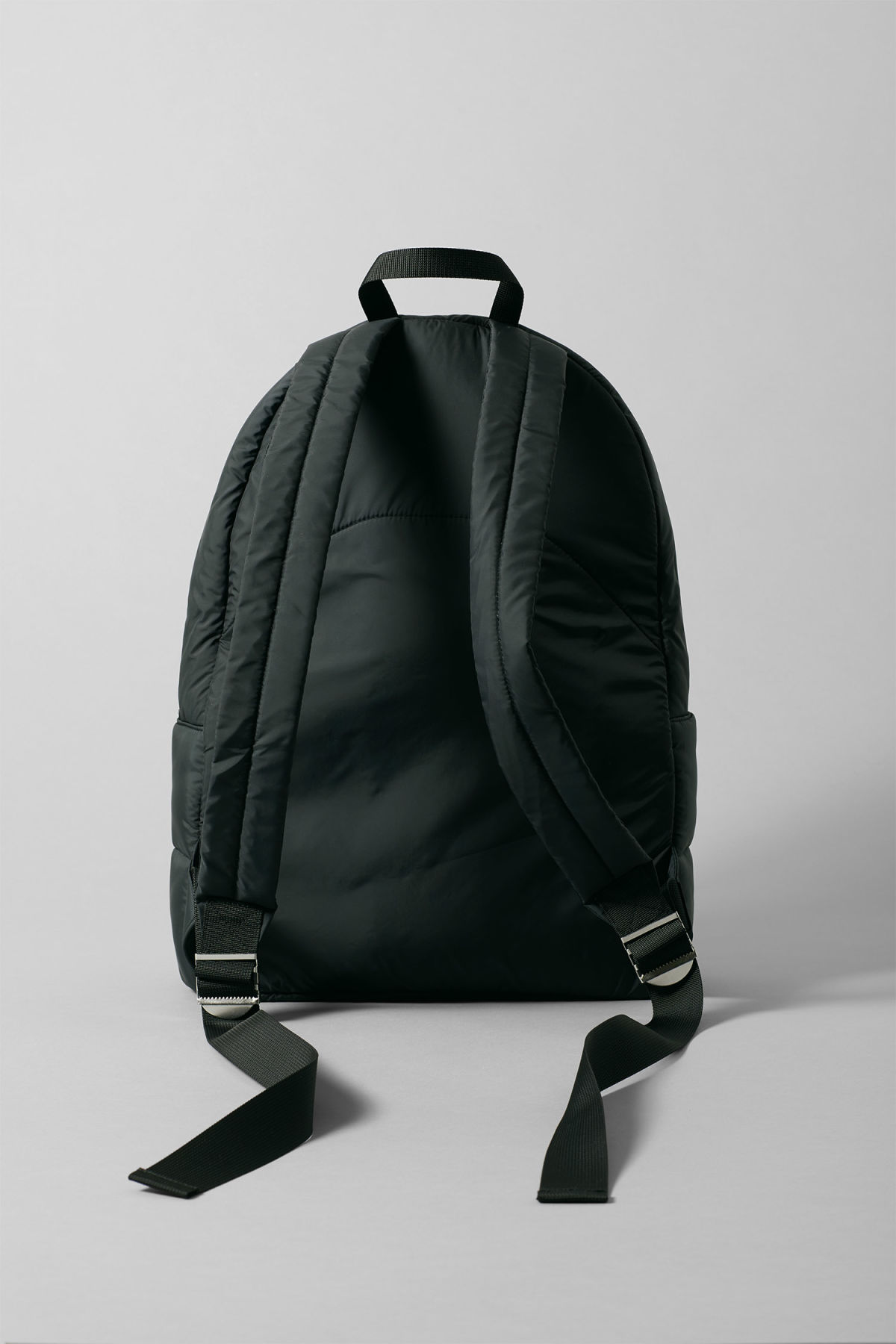 Side image of Weekday puff backpack in black
