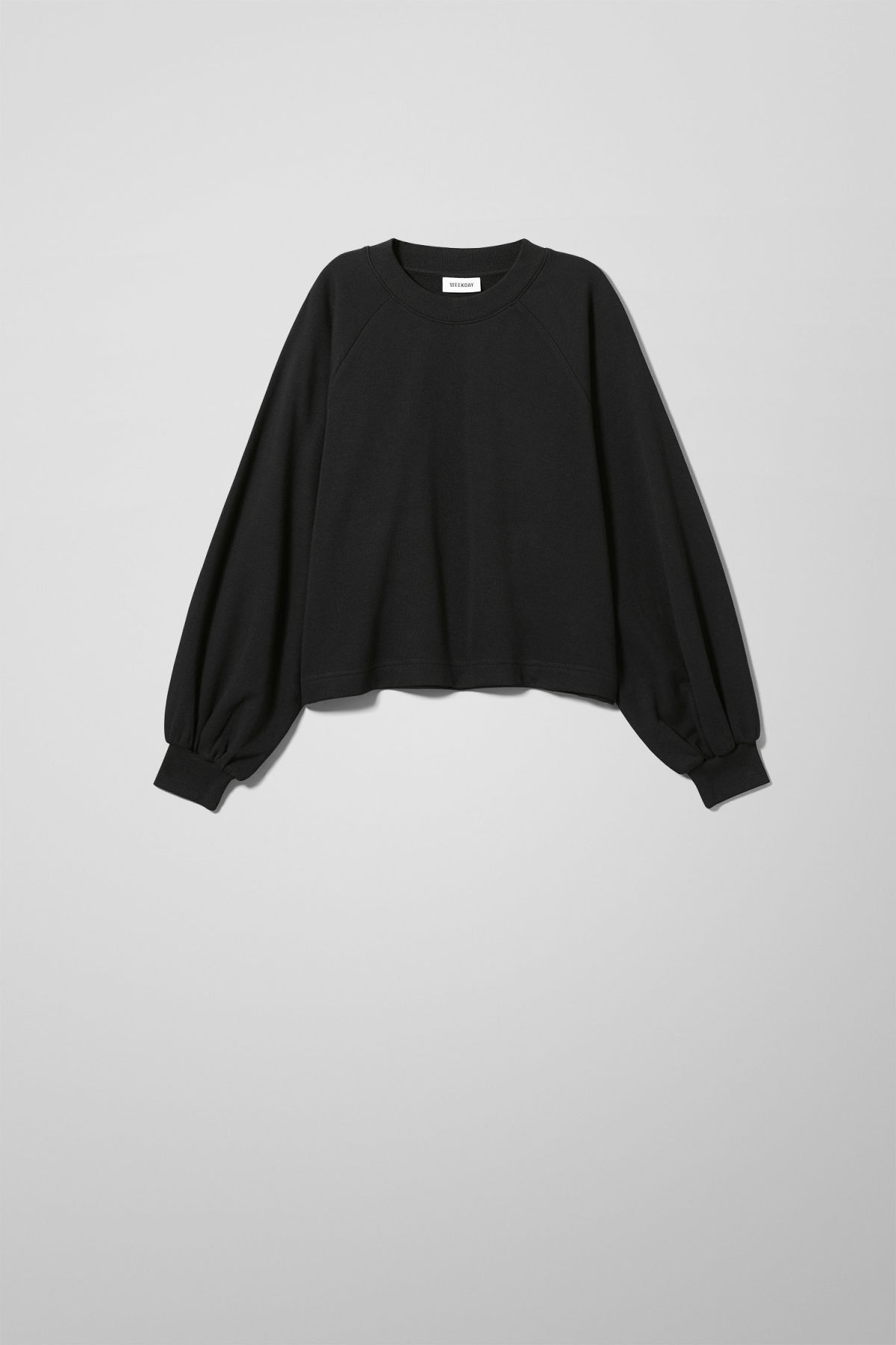 Front image of Weekday duff sweatshirt in black