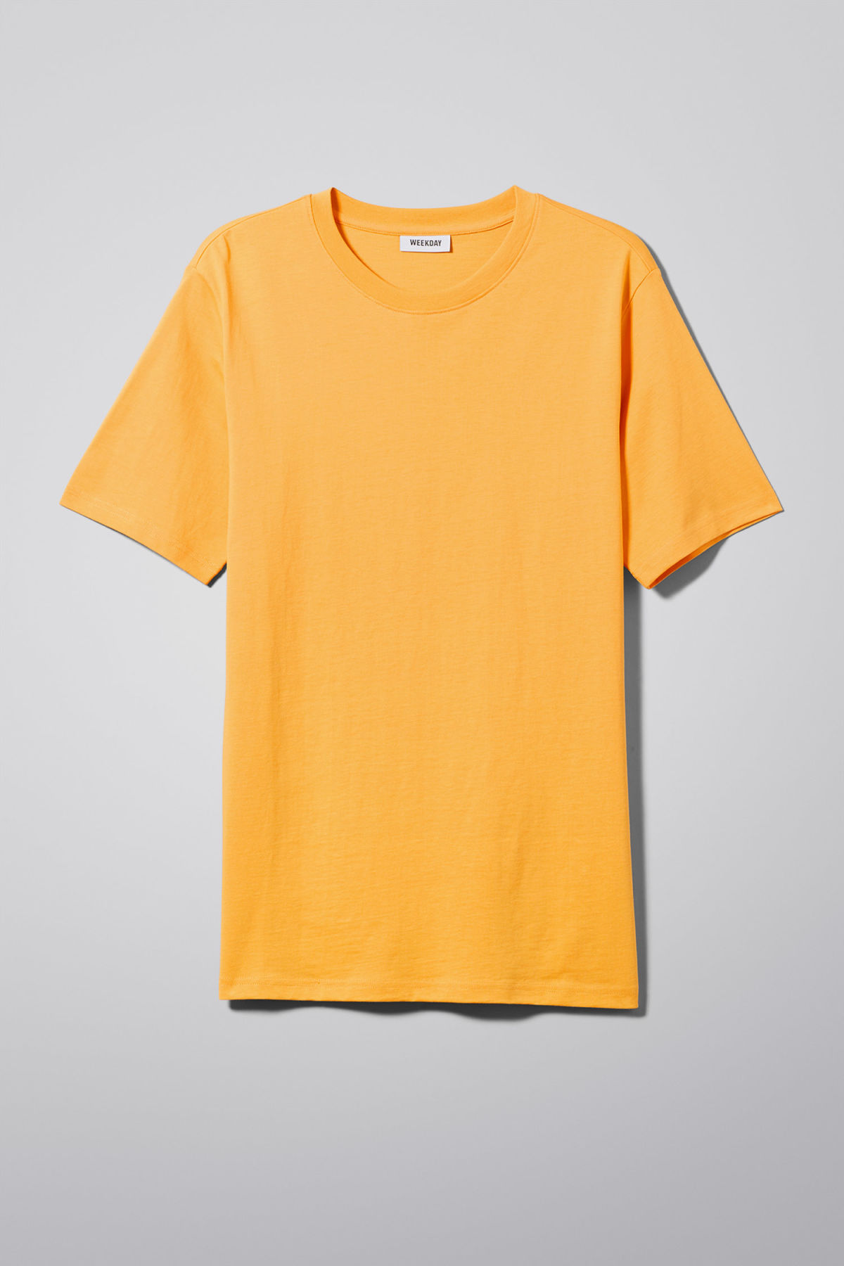Front image of Weekday frank proverb t-shirt in yellow