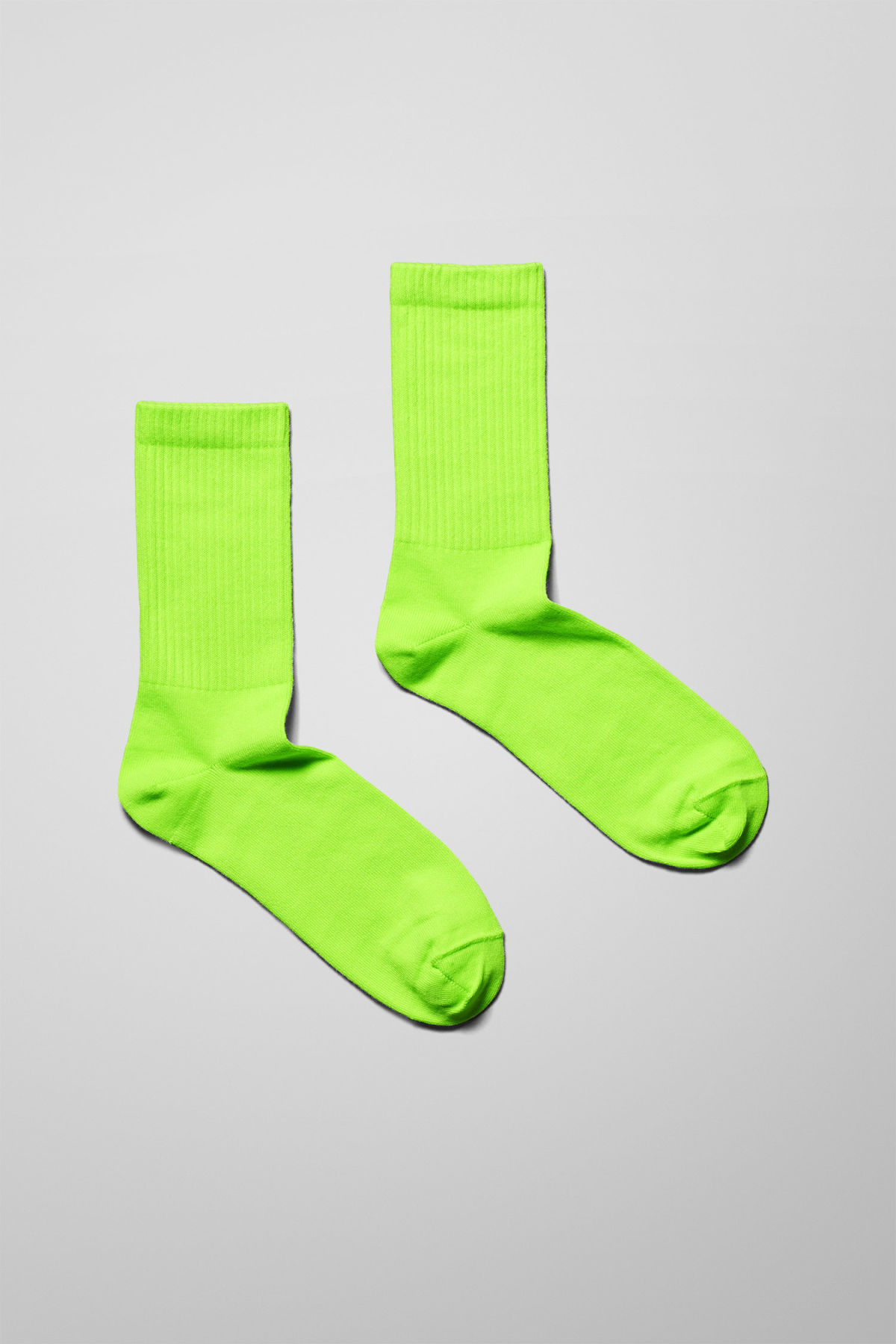 Front image of Weekday eleven socks in yellow