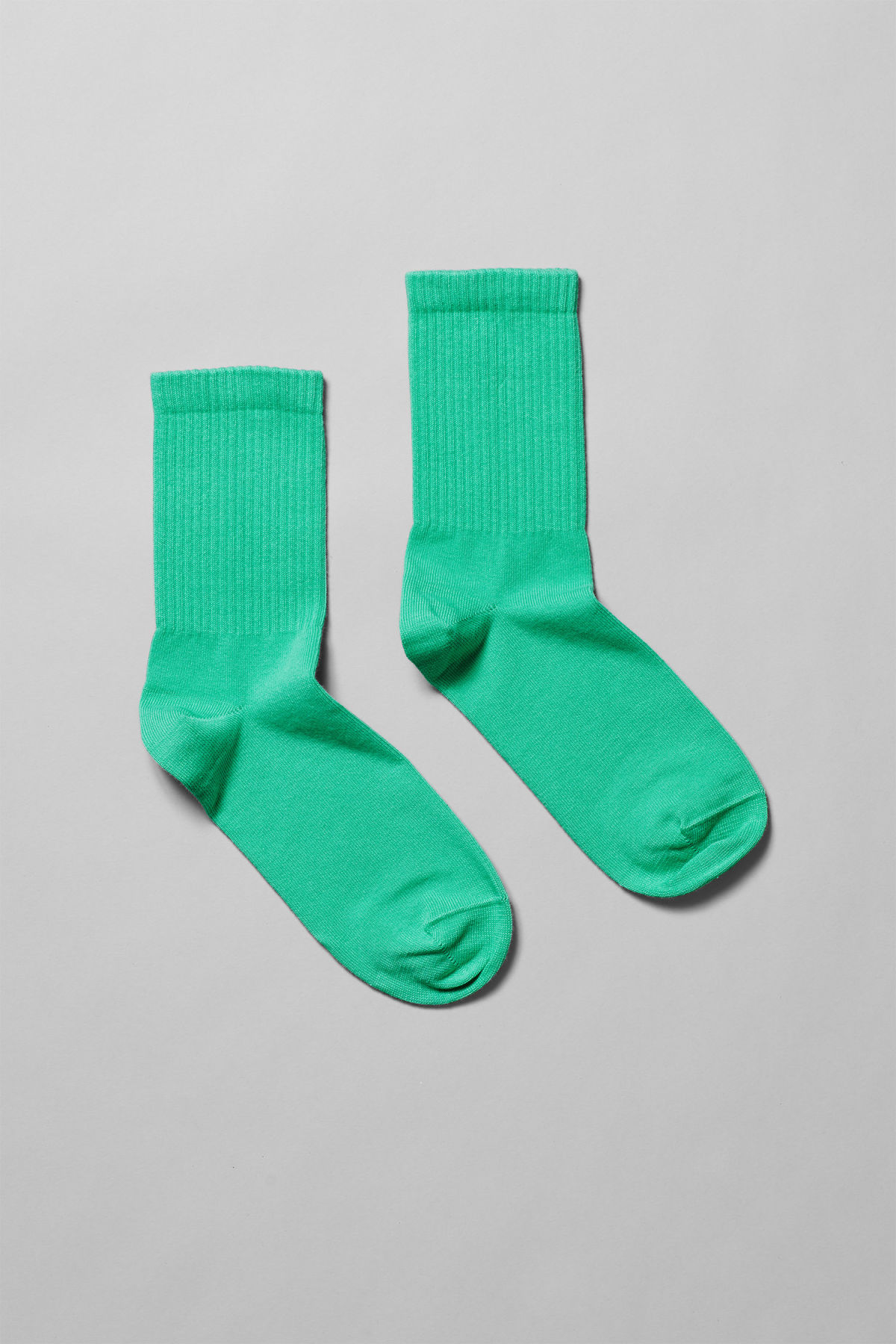 Front image of Weekday eleven sock in green