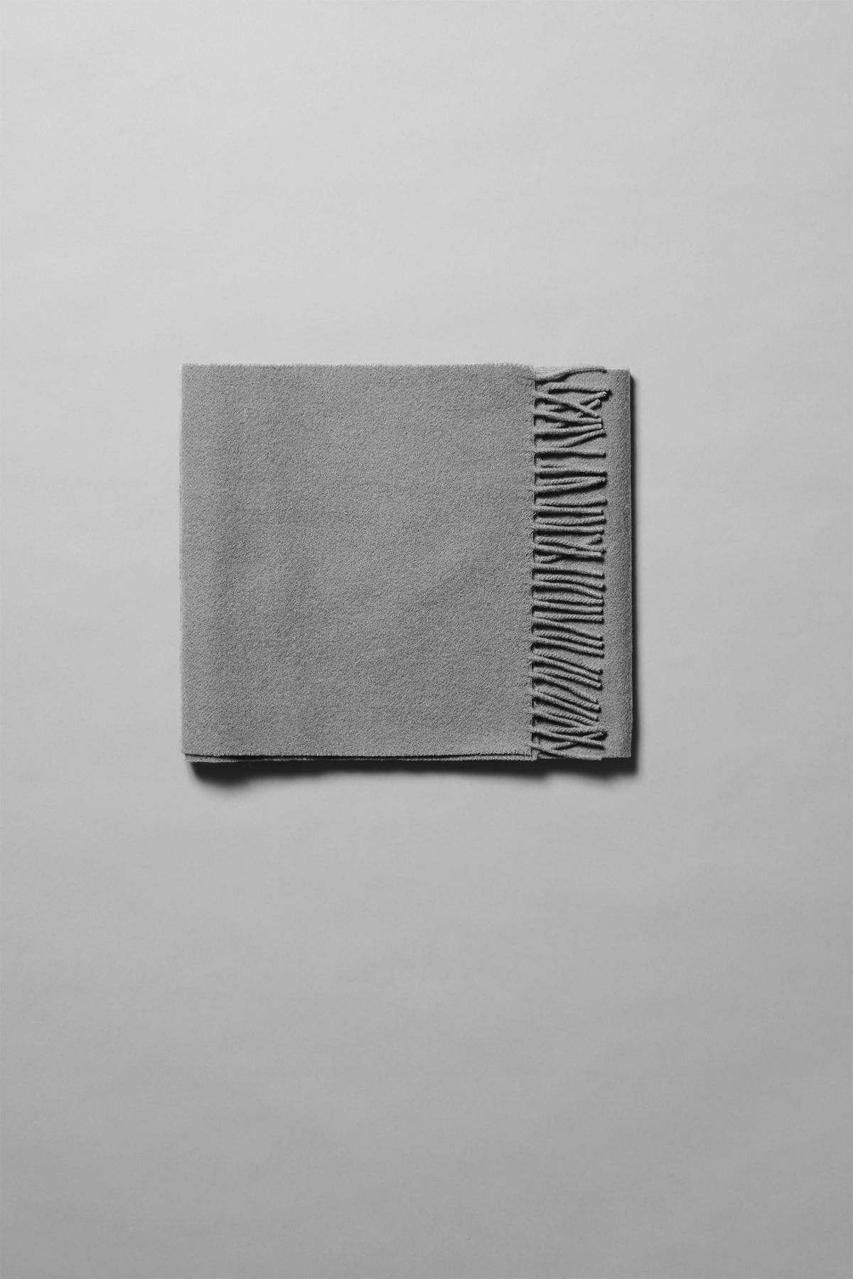 Front image of Weekday orbit scarf in grey