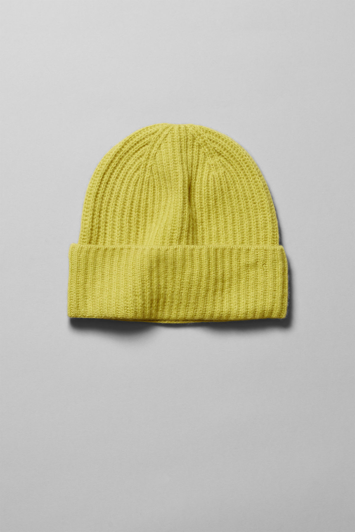 Front image of Weekday mon cashmere knit beanie in yellow