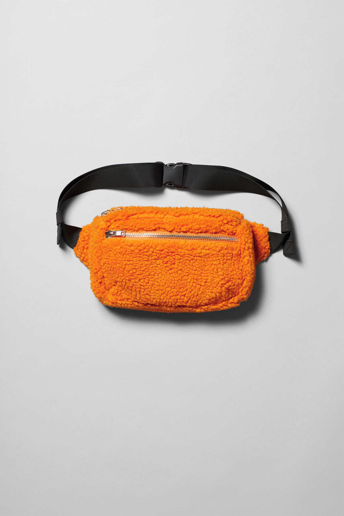 Front image of Weekday wood pile waist bag in orange