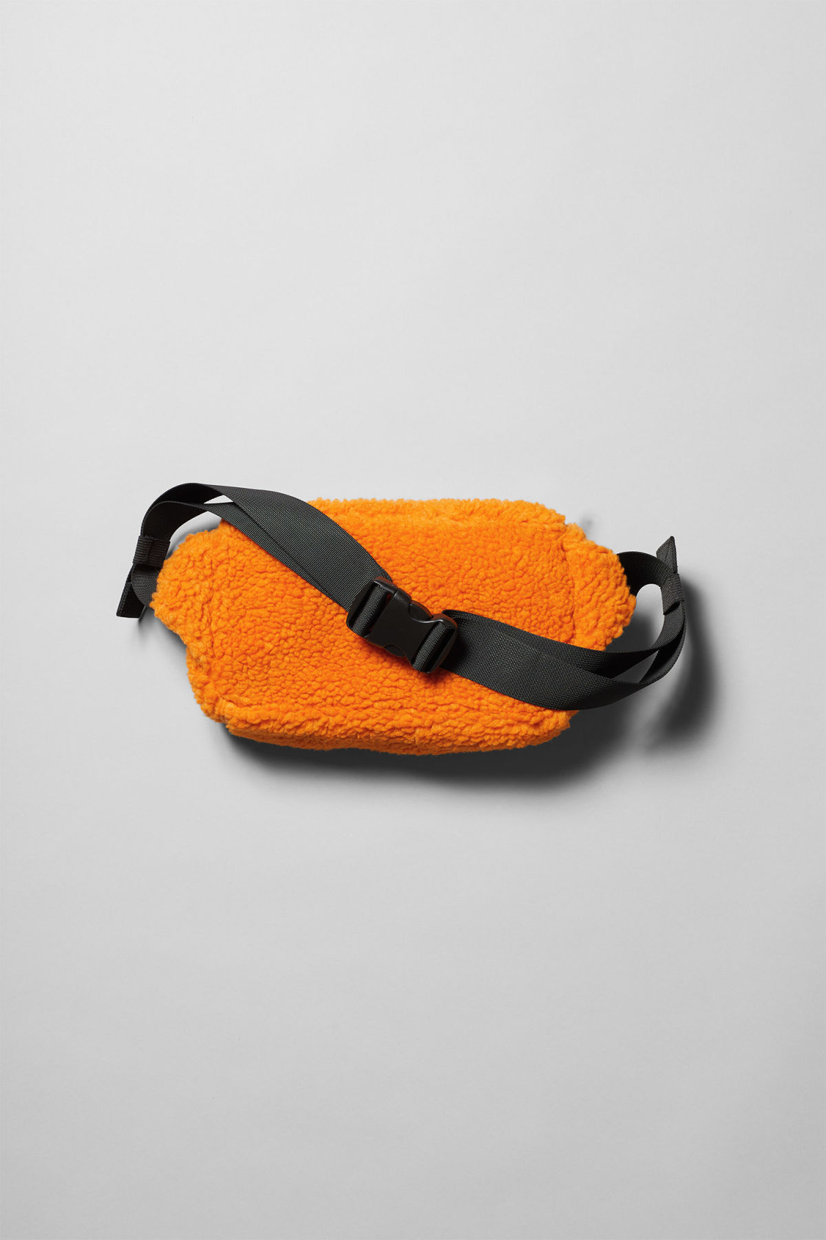 Back image of Weekday wood pile waist bag in orange