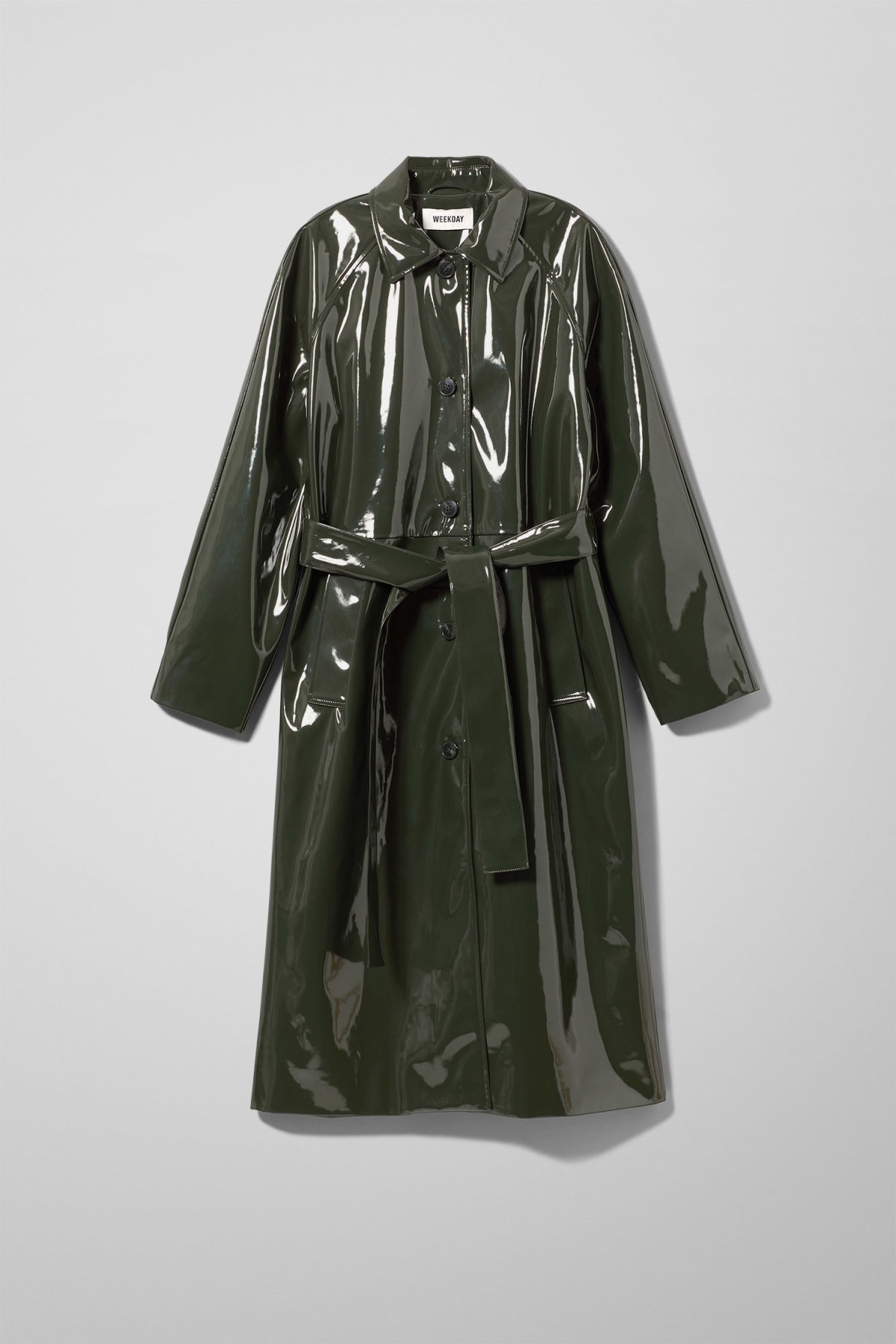 Front image of Weekday raven patent coat in green