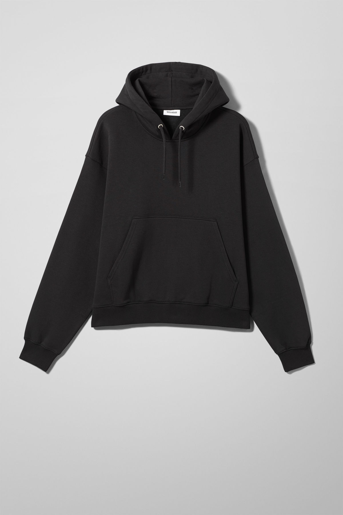 Front image of Weekday bird hoodie in black