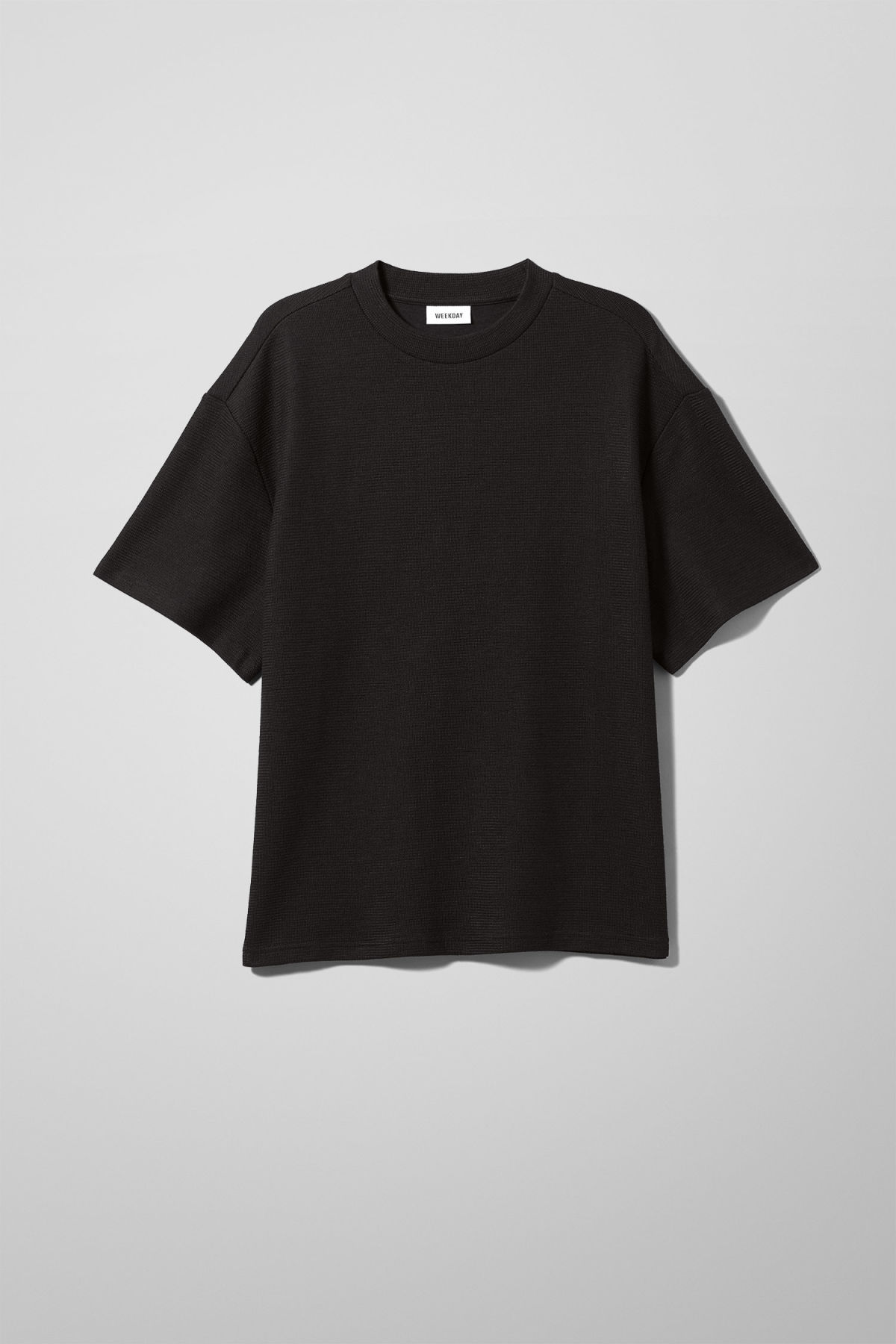 Front image of Weekday grand t-shirt in black