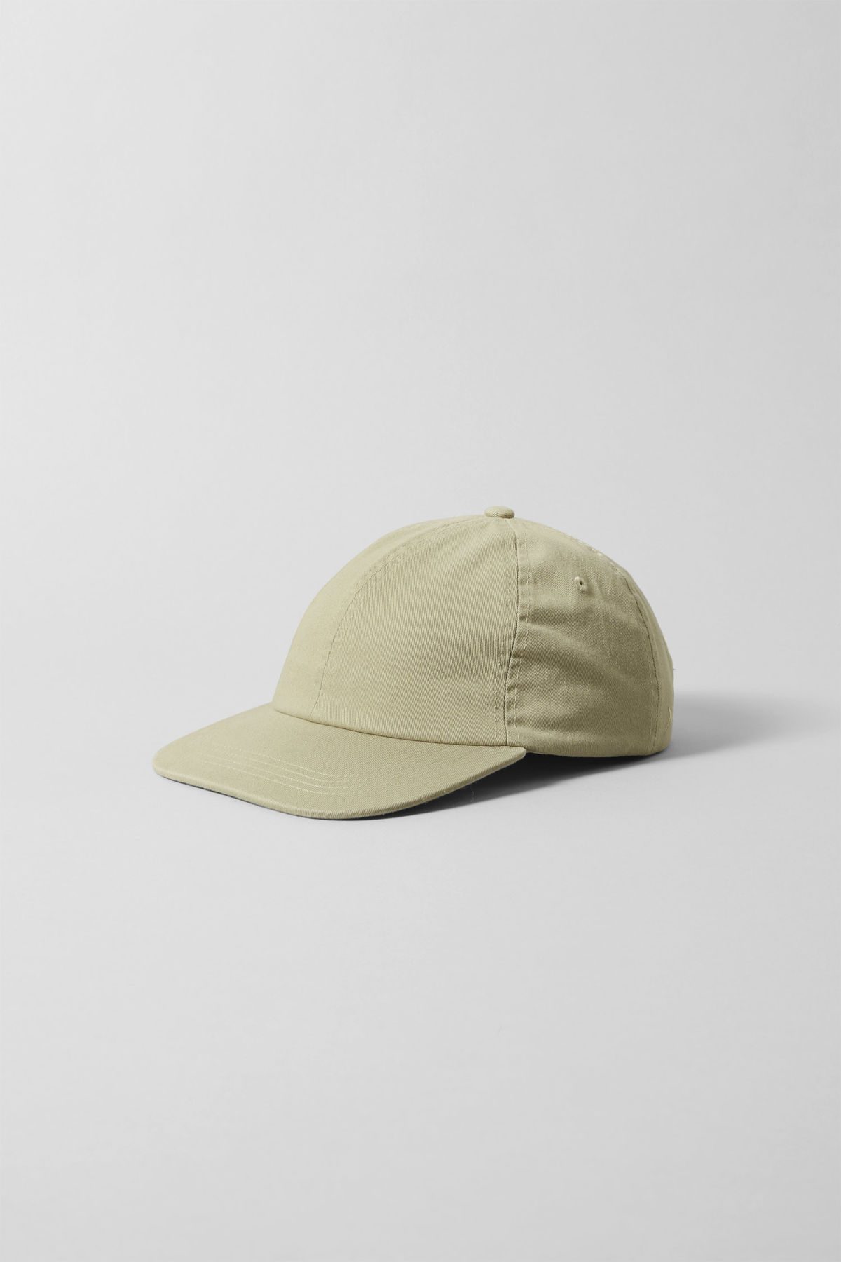 Front image of Weekday scan cap in green
