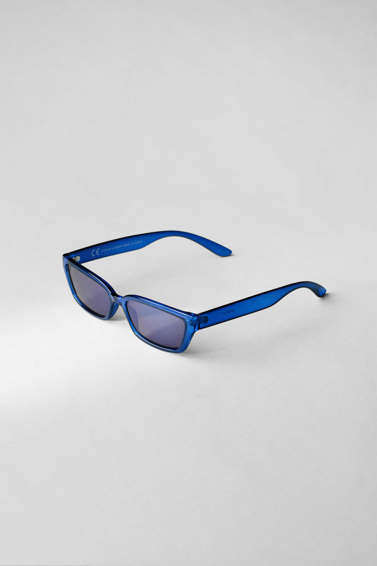 Back image of Weekday wave slim sunglasses in blue