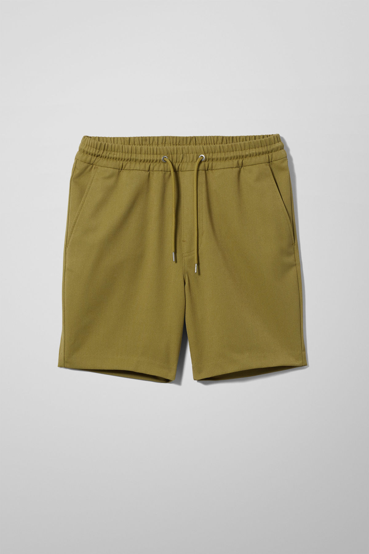 Front image of Weekday alf shorts  in green