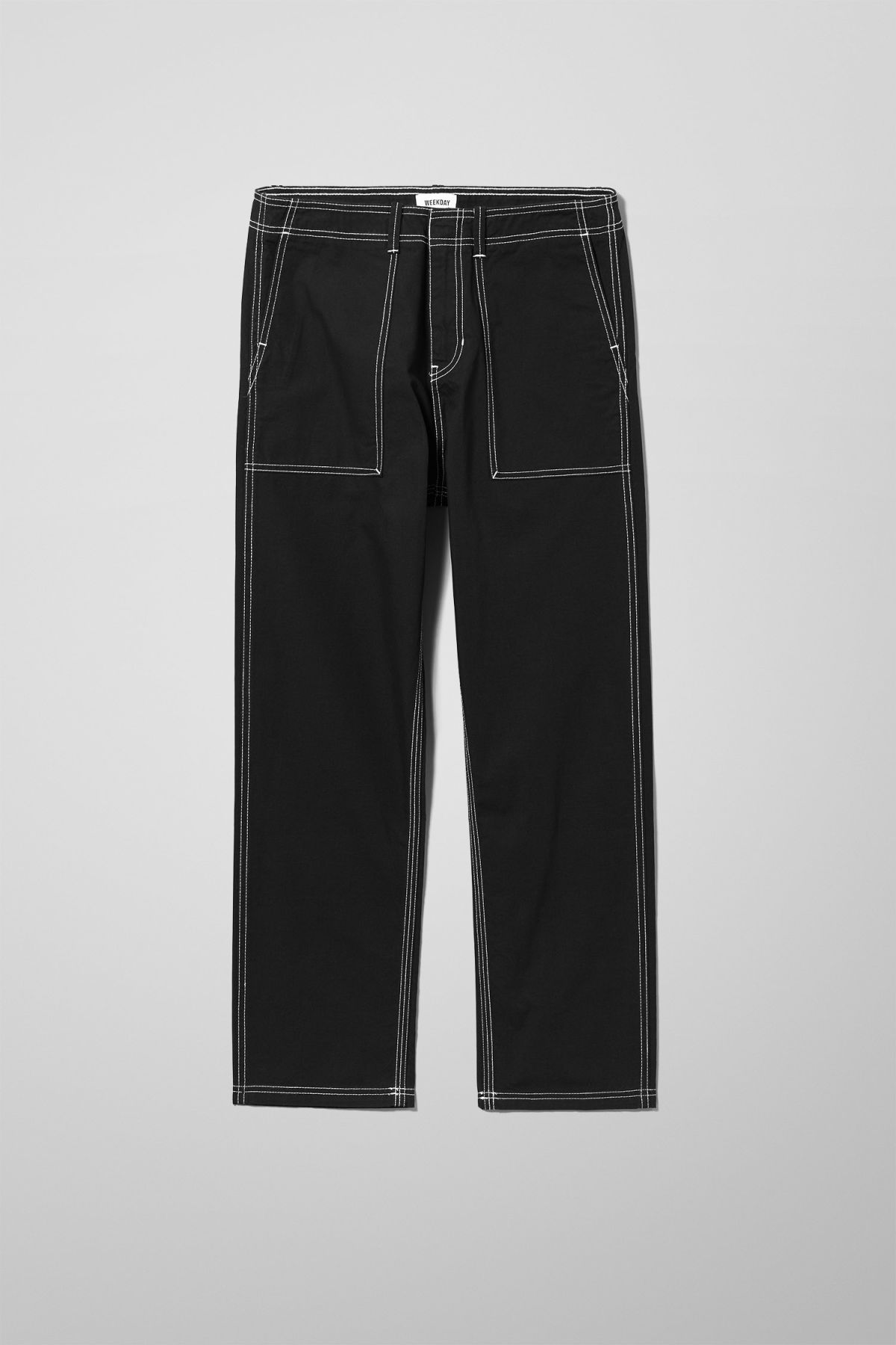 Front image of Weekday fowler chinos in black