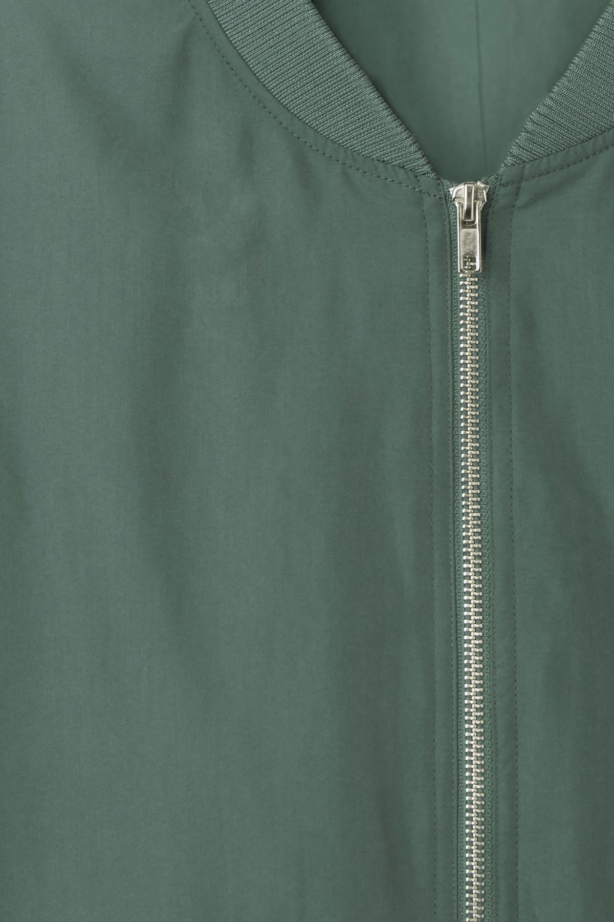 Detailed image of Weekday monoc bomber jacket in green