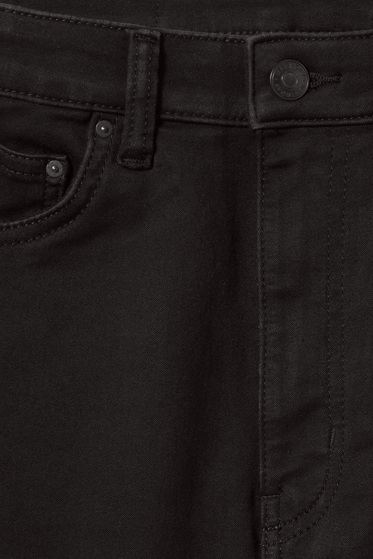 Detailed image of Weekday body high satin black jeans in black