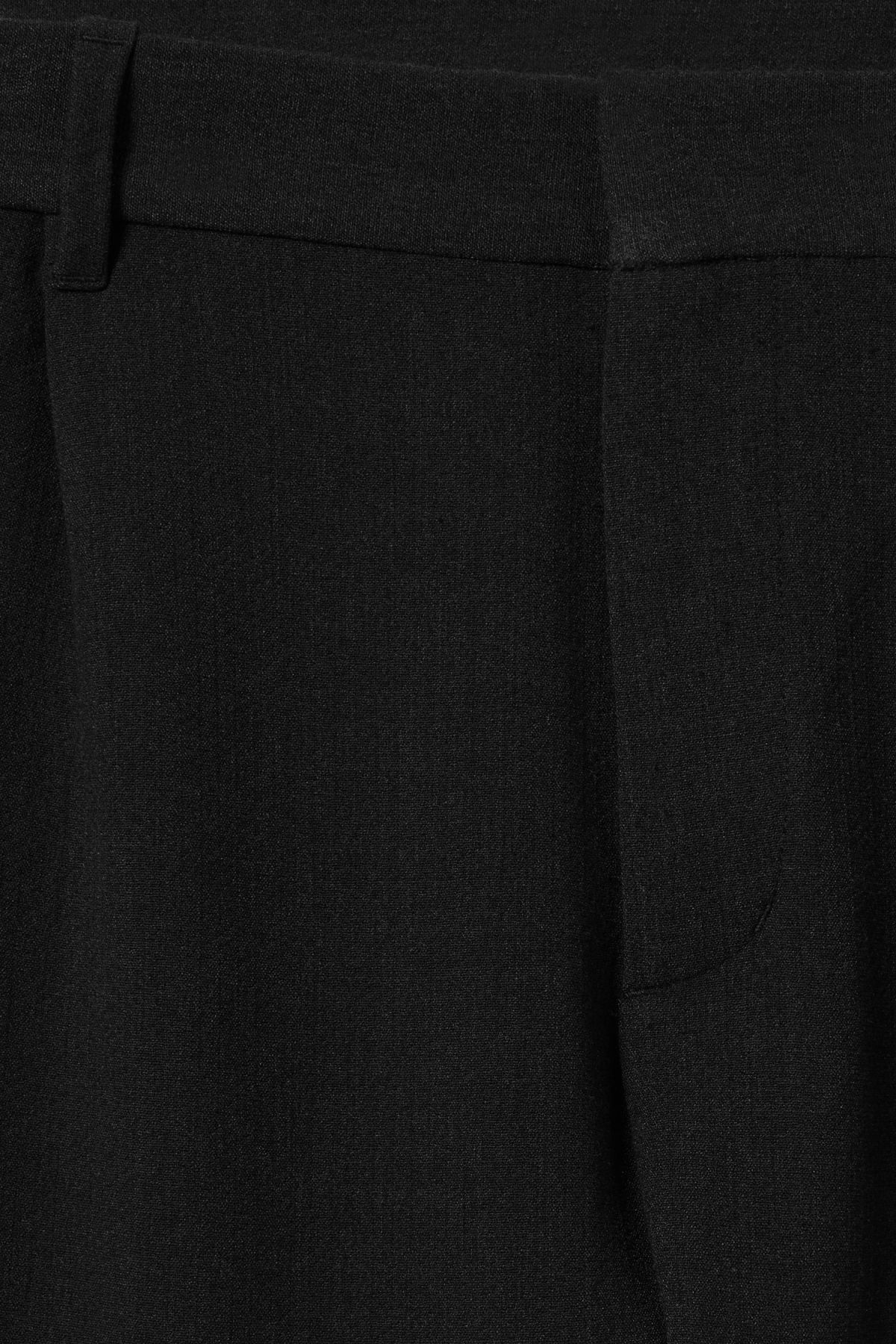 Detailed image of Weekday mard trousers in black