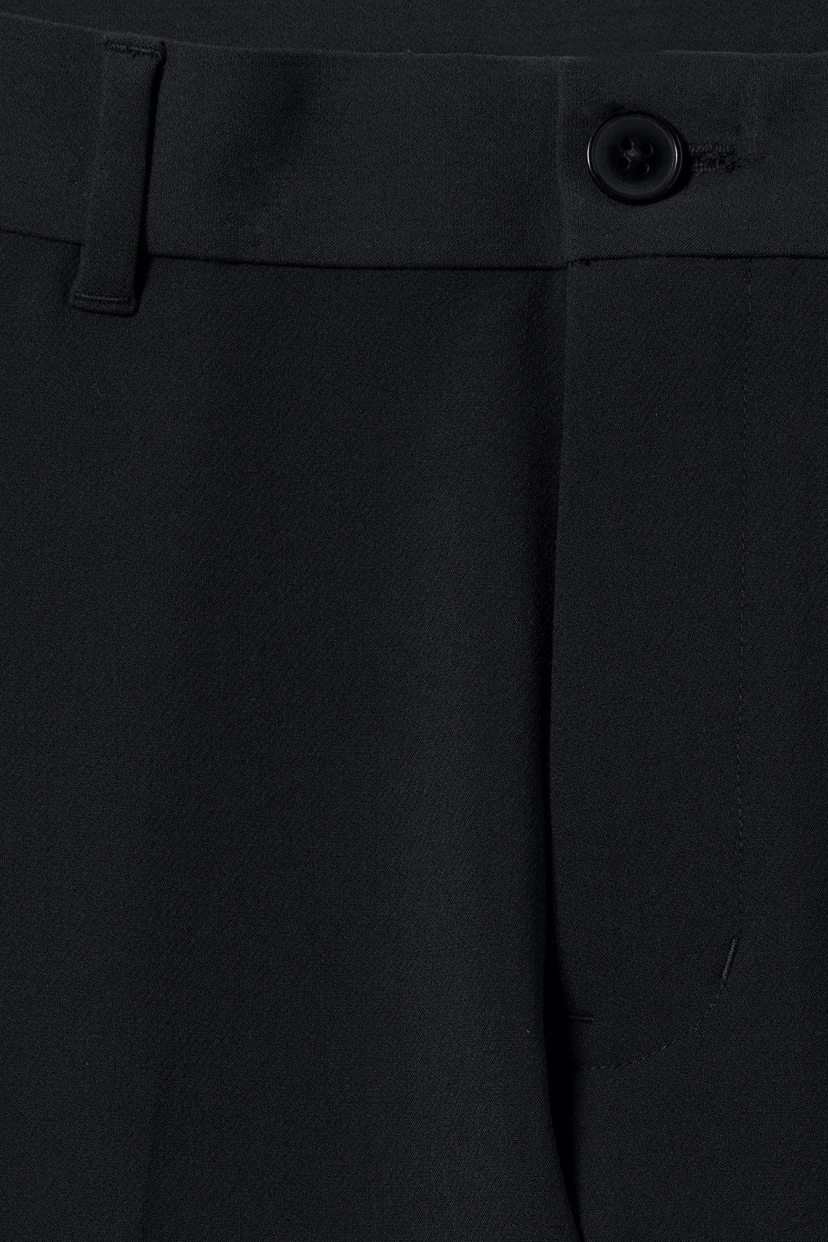 Detailed image of Weekday riffle trousers  in black