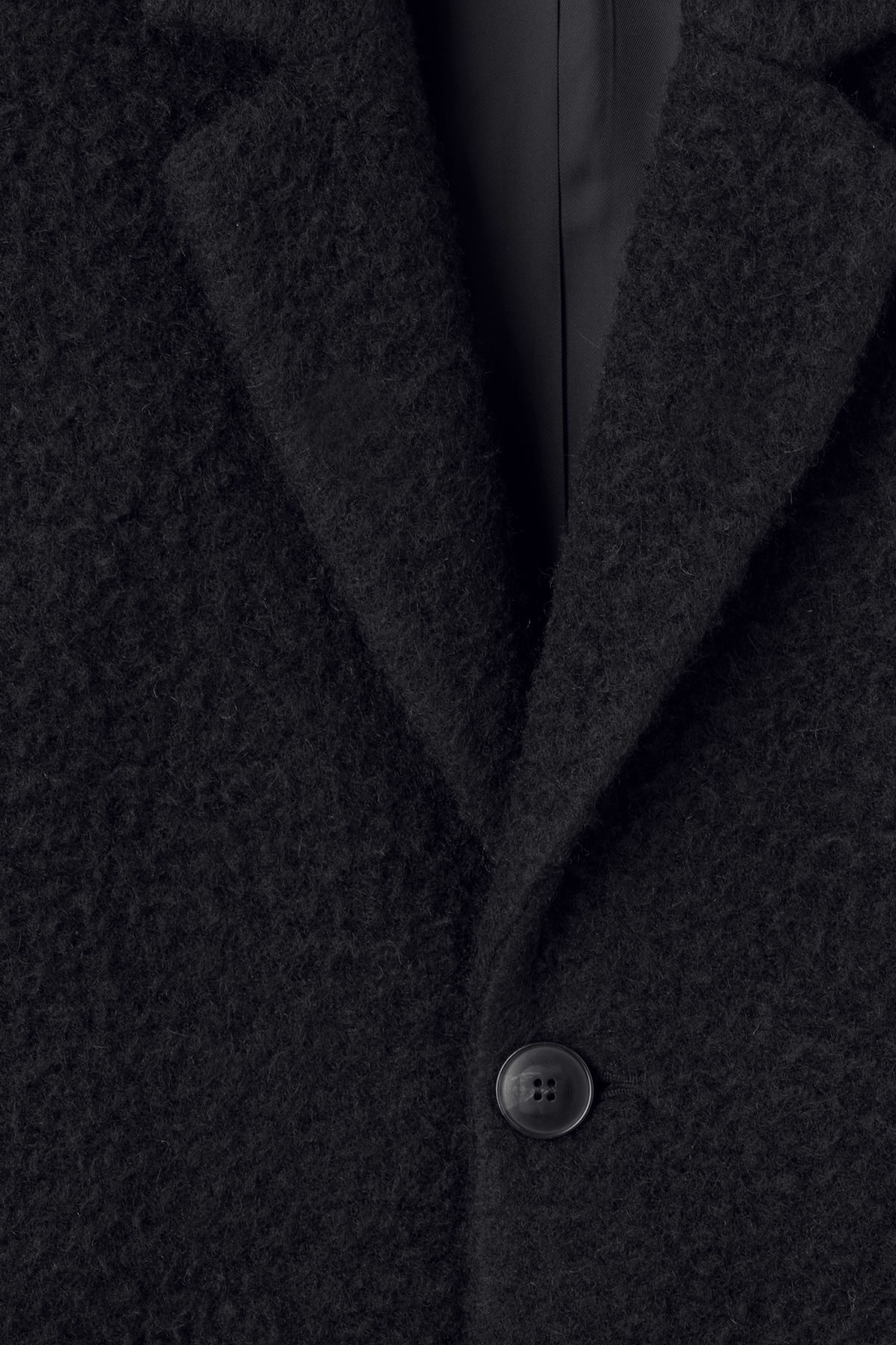 Detailed image of Weekday zeke knitted coat in black
