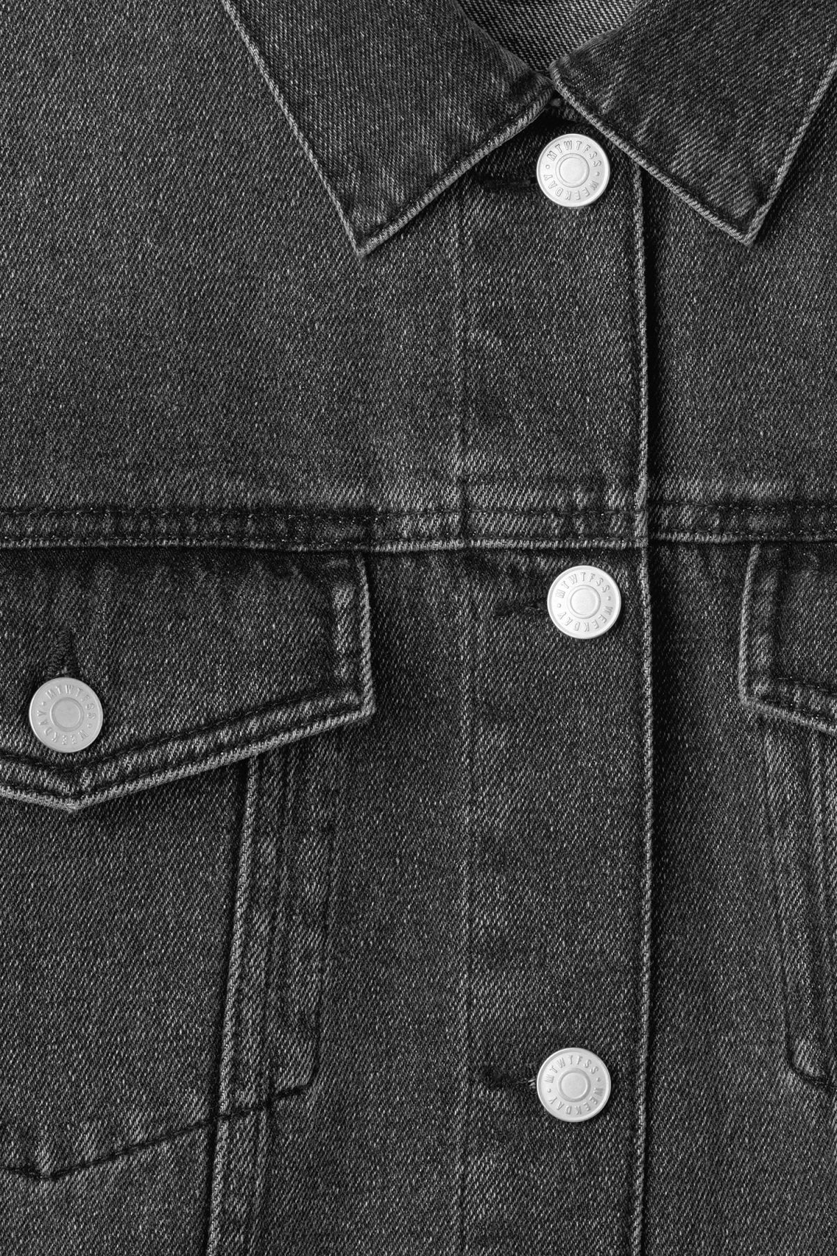 Detailed image of Weekday double denim jacket in black