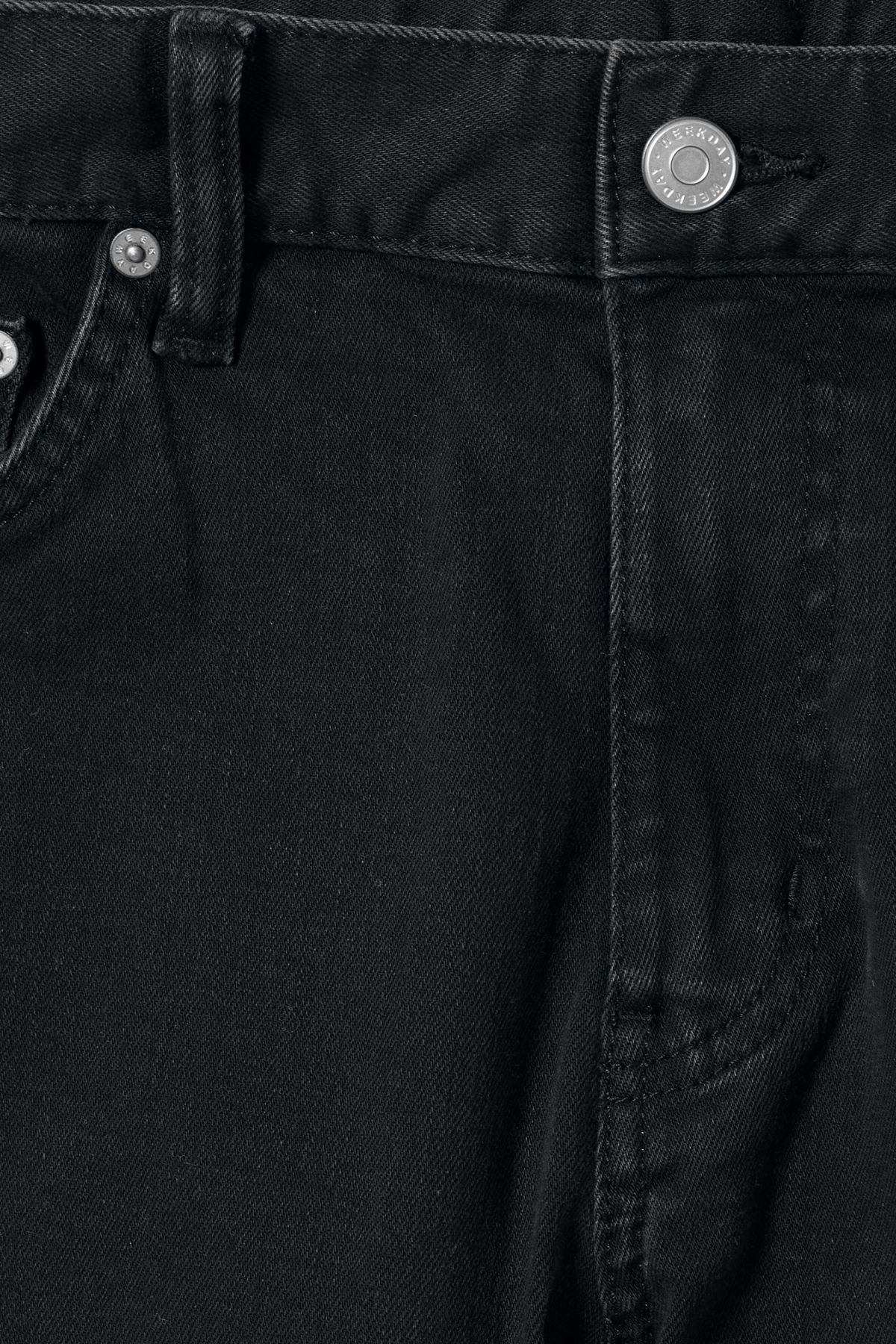 Detailed image of Weekday vacant rinsed black jeans in black