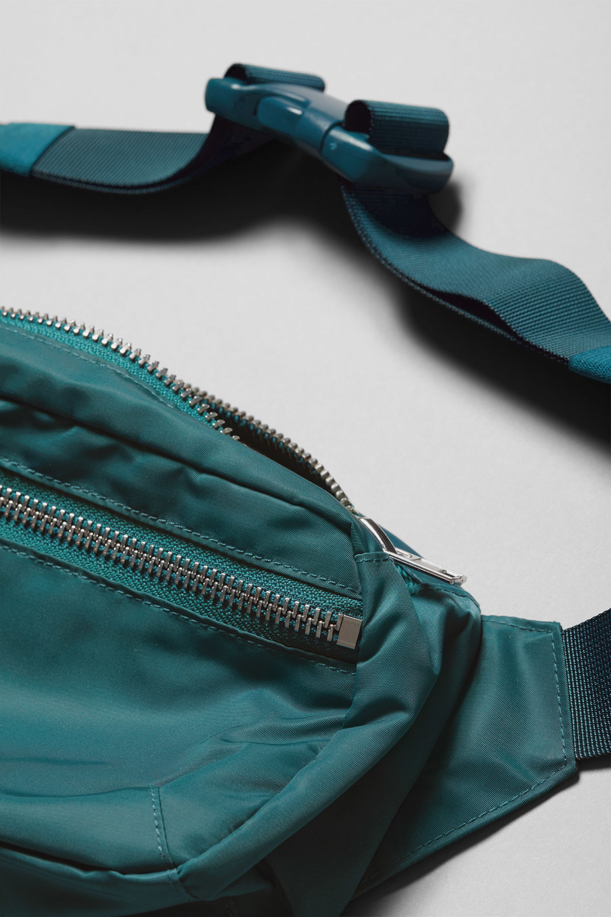 Detailed image of Weekday wood waist bag in turquoise