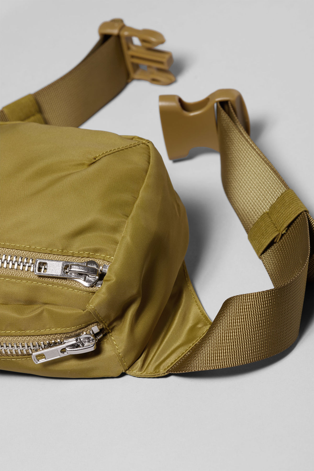 Detailed image of Weekday wood waist bag in yellow