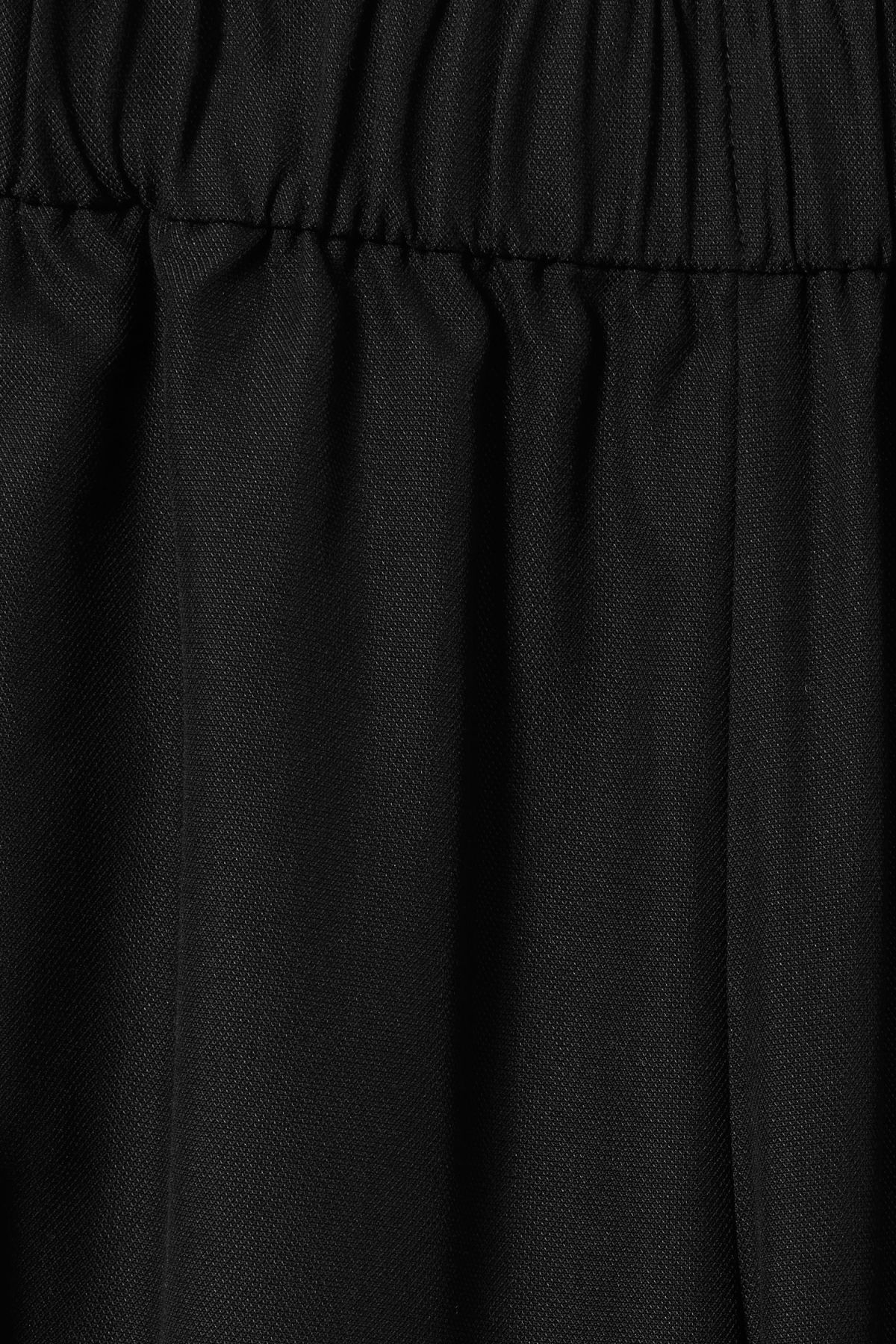 Detailed image of Weekday amelia woven trousers in black