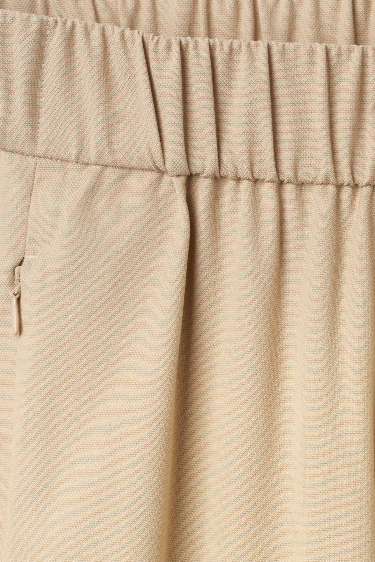 Detailed image of Weekday amelia woven trousers in beige