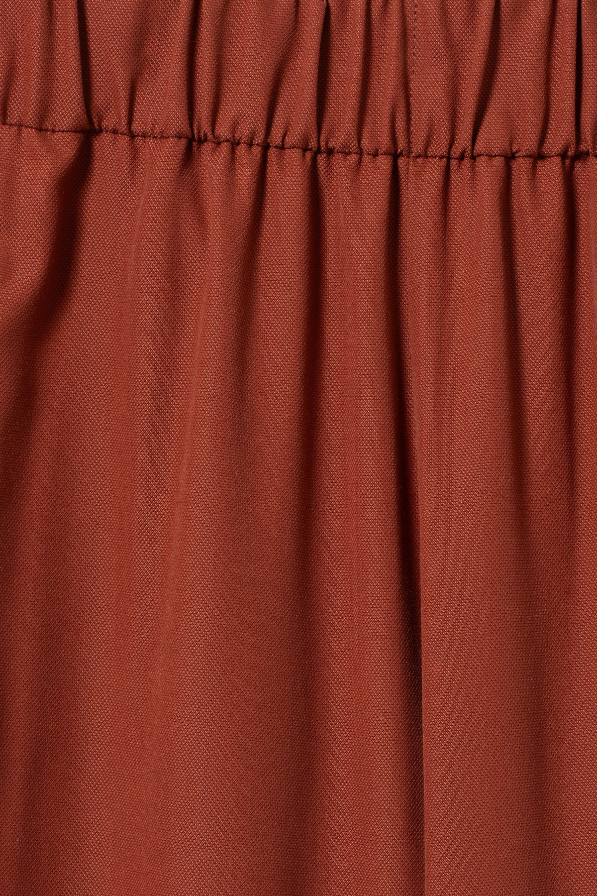 Detailed image of Weekday amelia woven trousers in orange