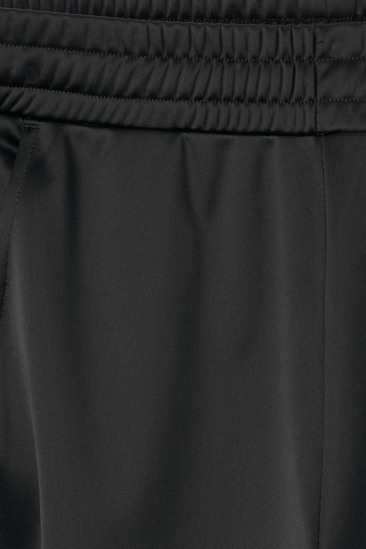 Detailed image of Weekday strap track pants in black