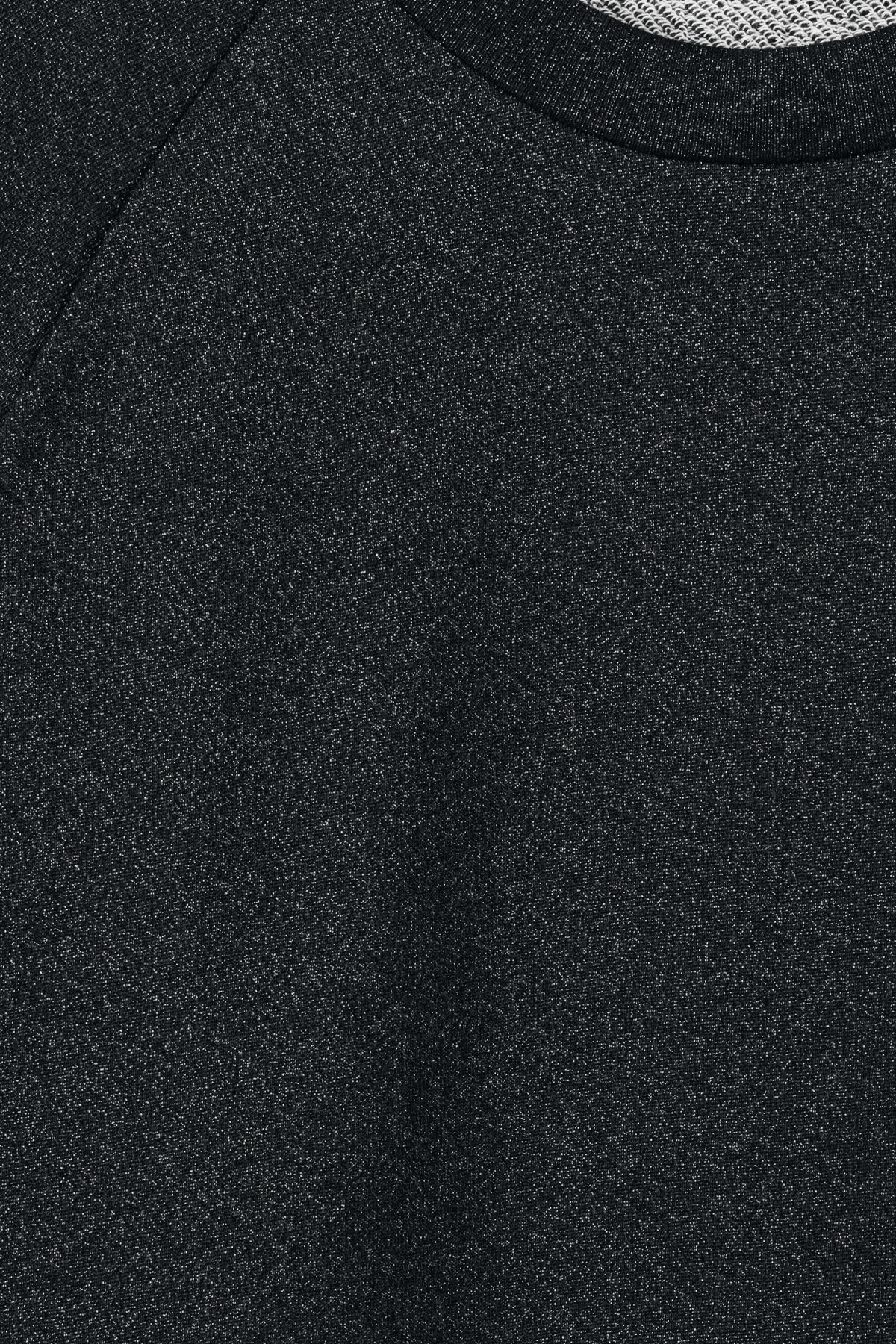 Detailed image of Weekday curt glitter sweatshirt in black