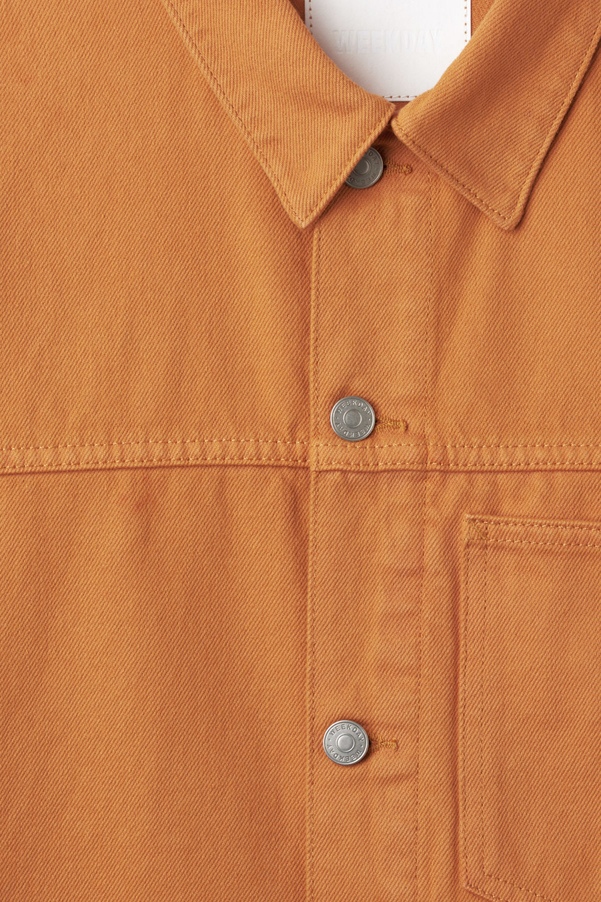 Detailed image of Weekday core  burned jacket in orange