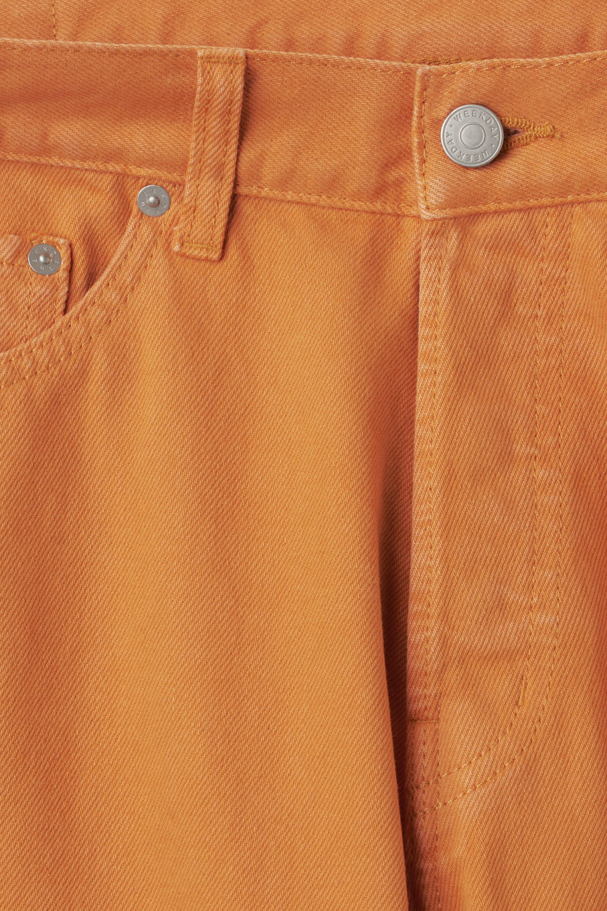 Detailed image of Weekday vacant cropped burned jeans in orange