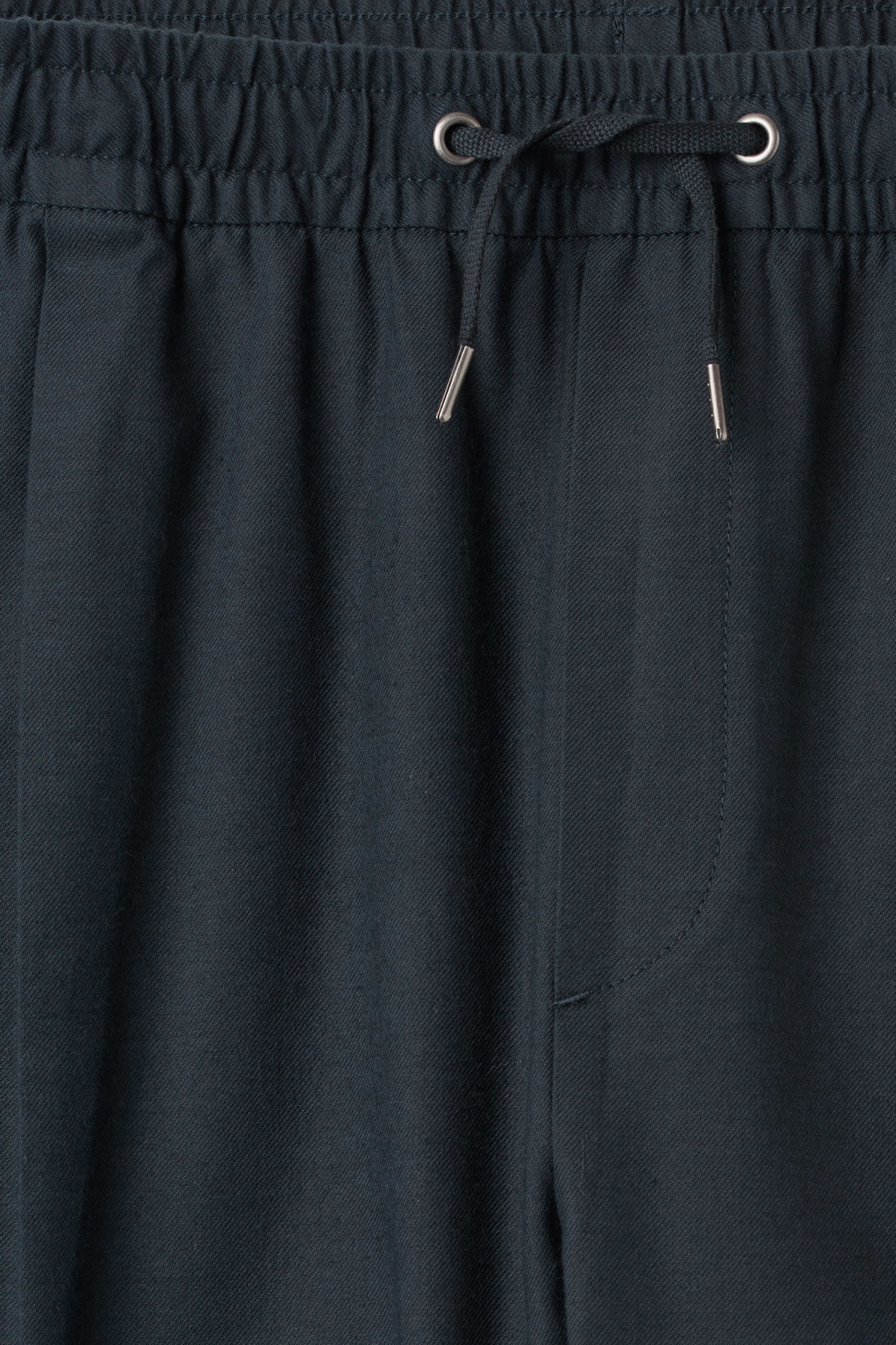 Detailed image of Weekday thriller woven joggers in blue